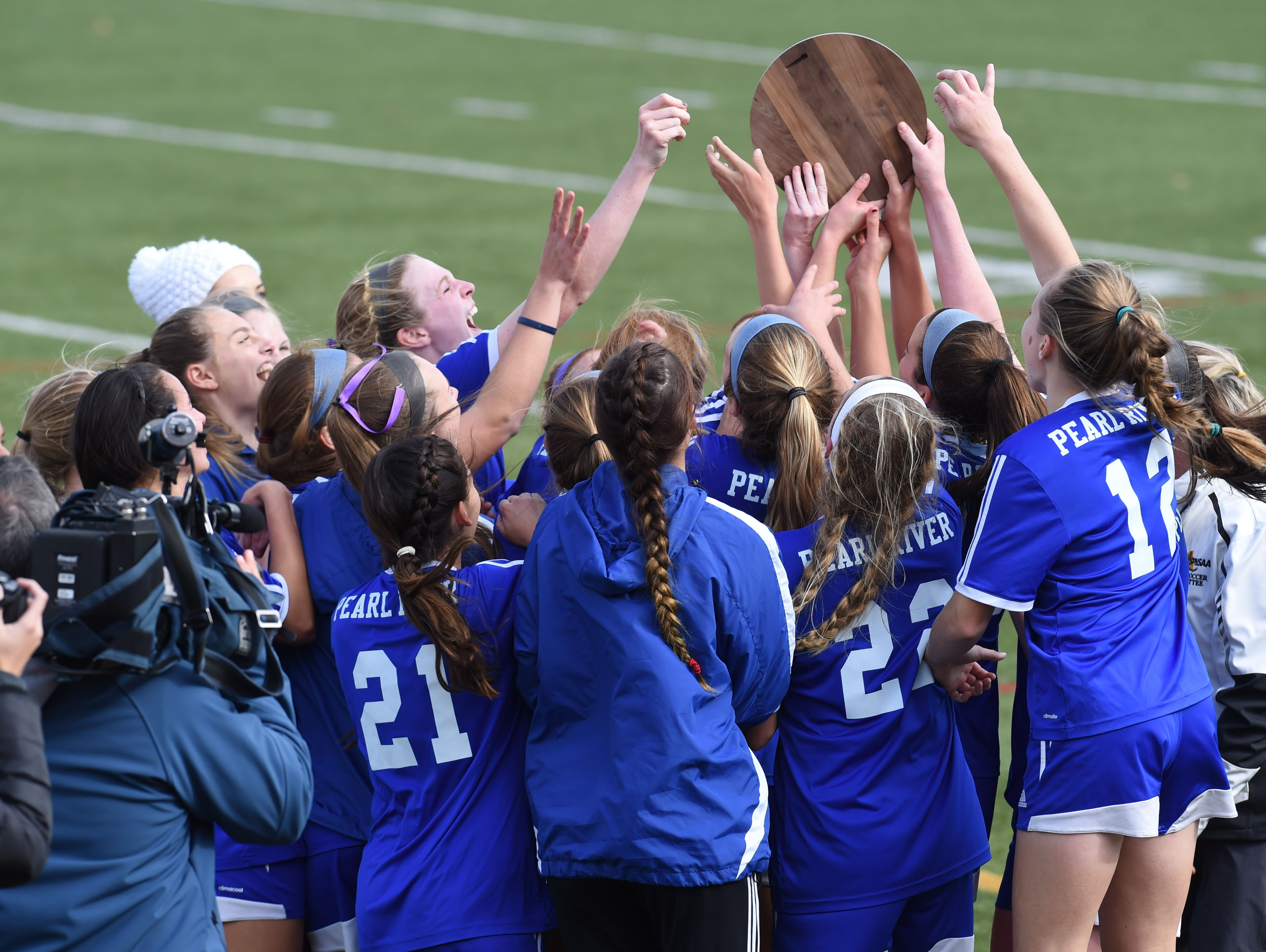 The Pearl River girls soccer team celebrates after winning the Class A regional final against Goshen.