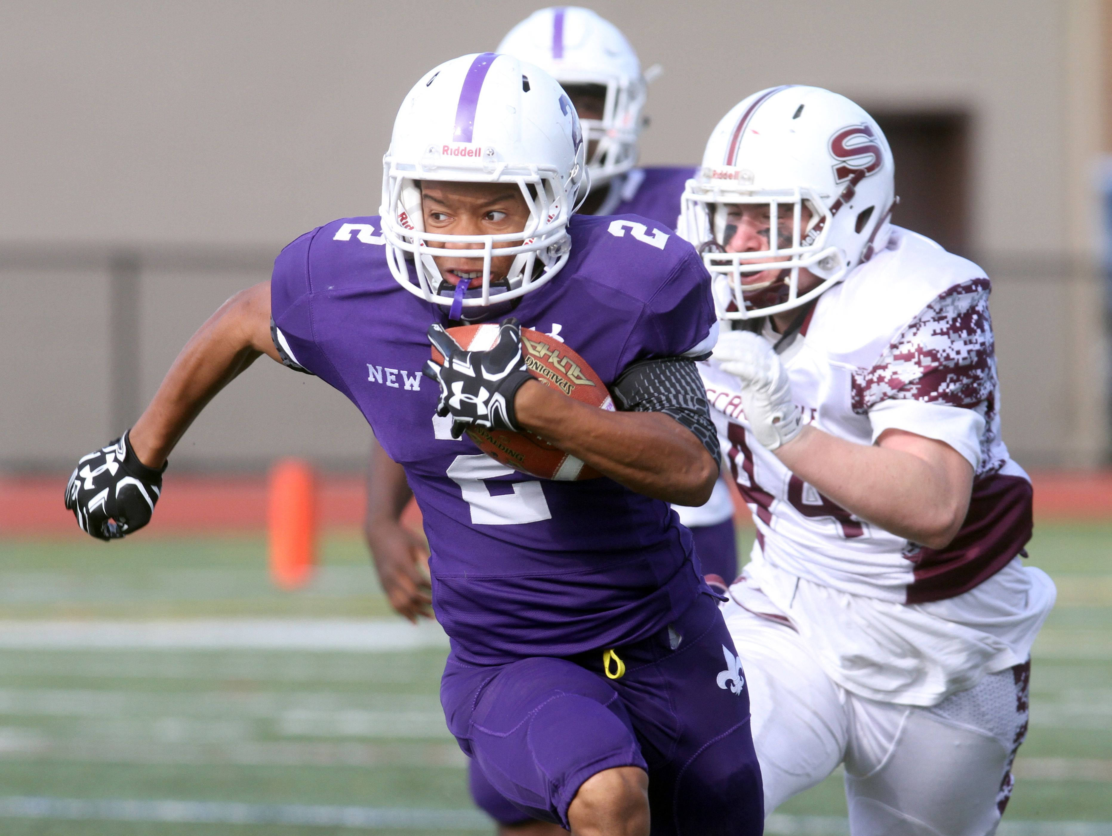 New Rochelle's Romeo Holden rushes during the Section 1 Class AA football championship against Scarsdale at Mahopac High School Nov. 6, 2016. Scarsdale defeated Scarsdale 41-13 in