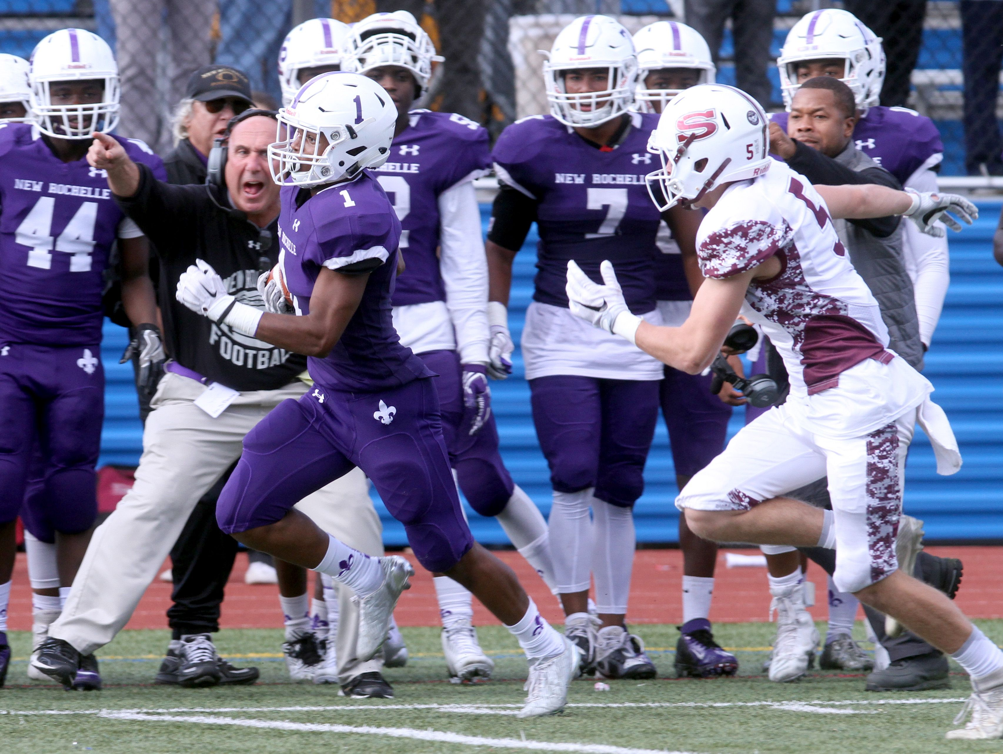 New Rochelle's Najee Bass rushes for a 79 yard touchdown during the Section 1 Class AA football championship against Scarsdale at Mahopac High School Nov. 6, 2016. New Rochelle defeated Scarsdale 41-13.