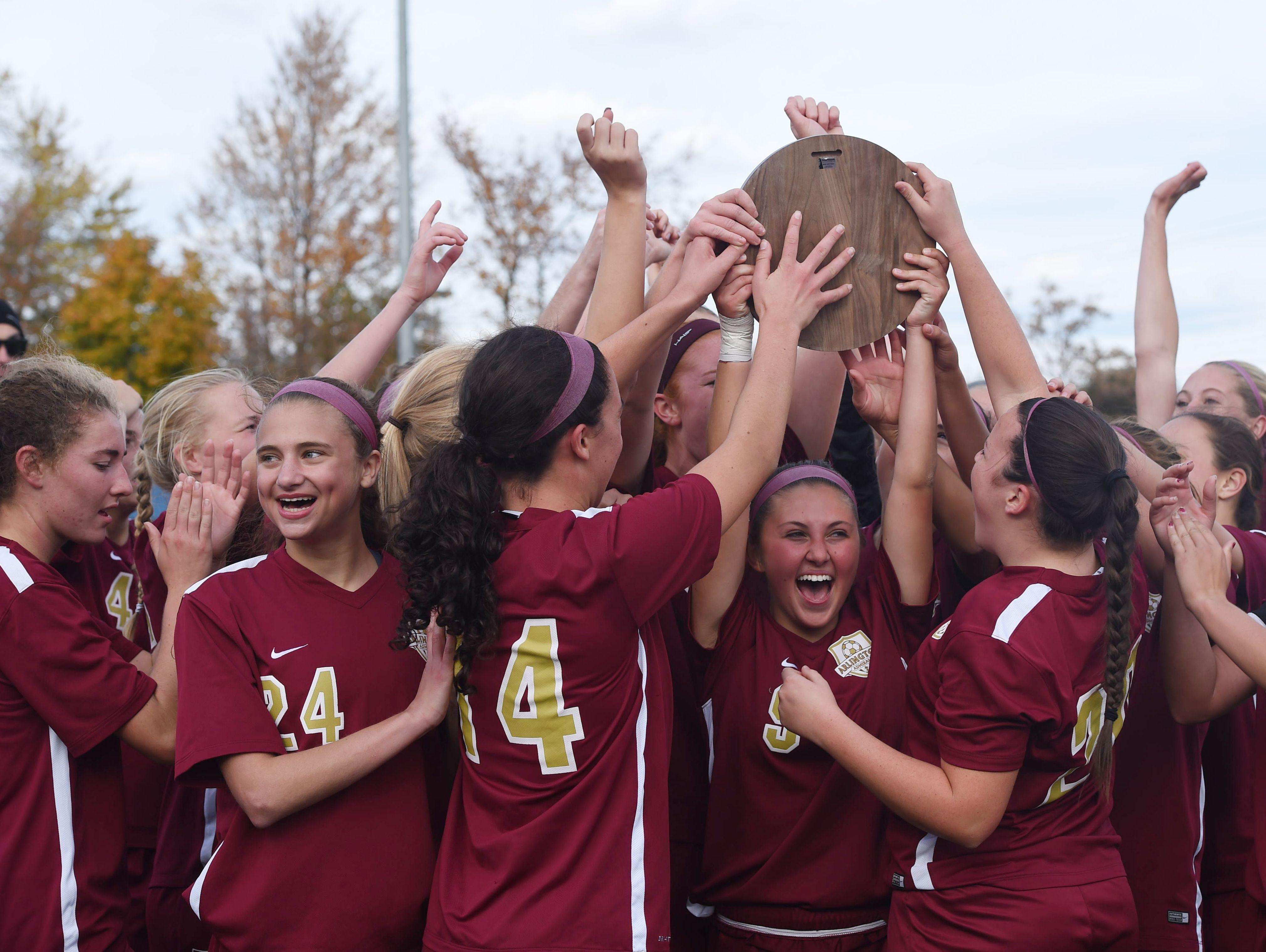 The Arlington girls soccer team celebrates after winning the Class AA regional final against Monroe-Woodbury.