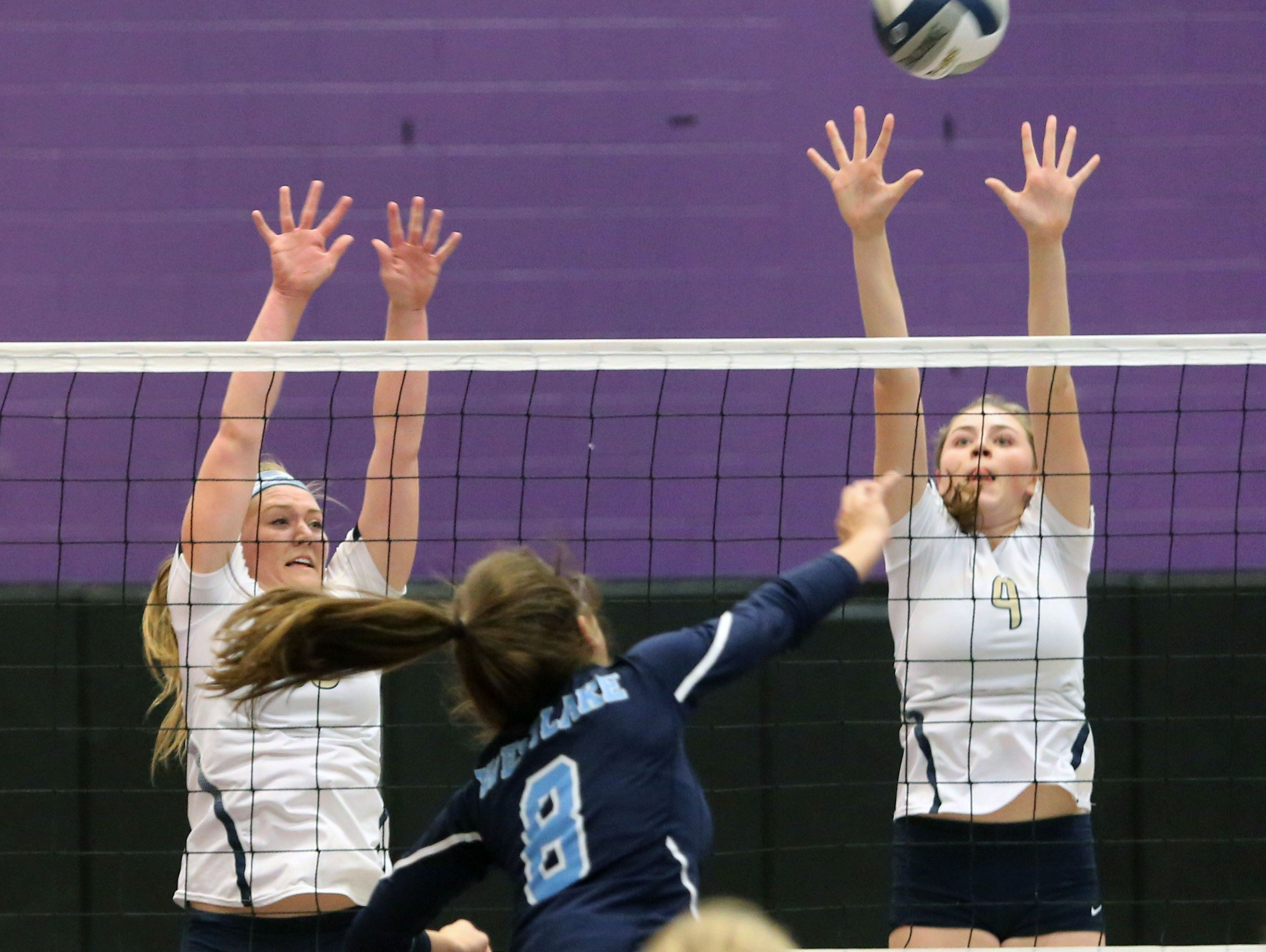 Westlake's Sydney Roell fires a shot toward Lourdes' Grace McElduff and Grace Rappleyea during the Section 1 Class B volleyball final at John Jay High School in Cross River, Nov. 5, 2016.
