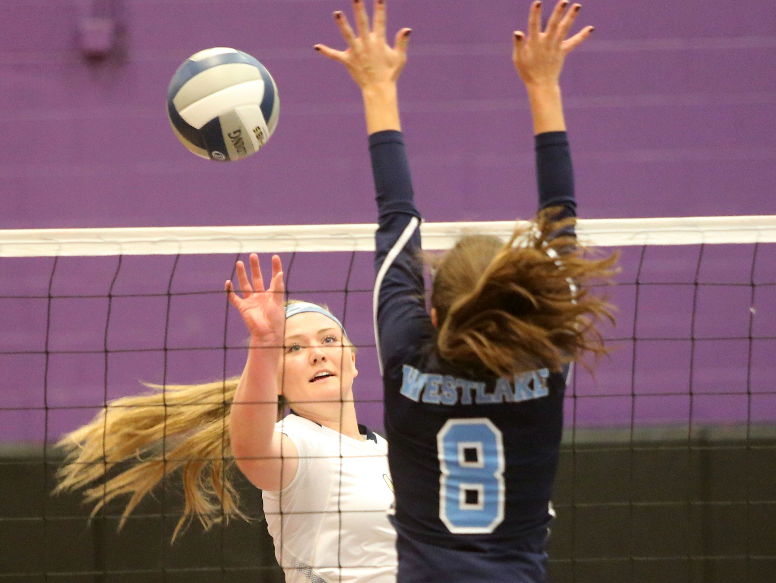 Lourdes' Grace McElduff hits the ball toward Westlake's Sydney Roell during the Section 1 Class B volleyball final at John Jay High School in Cross River, Nov. 5, 2016.