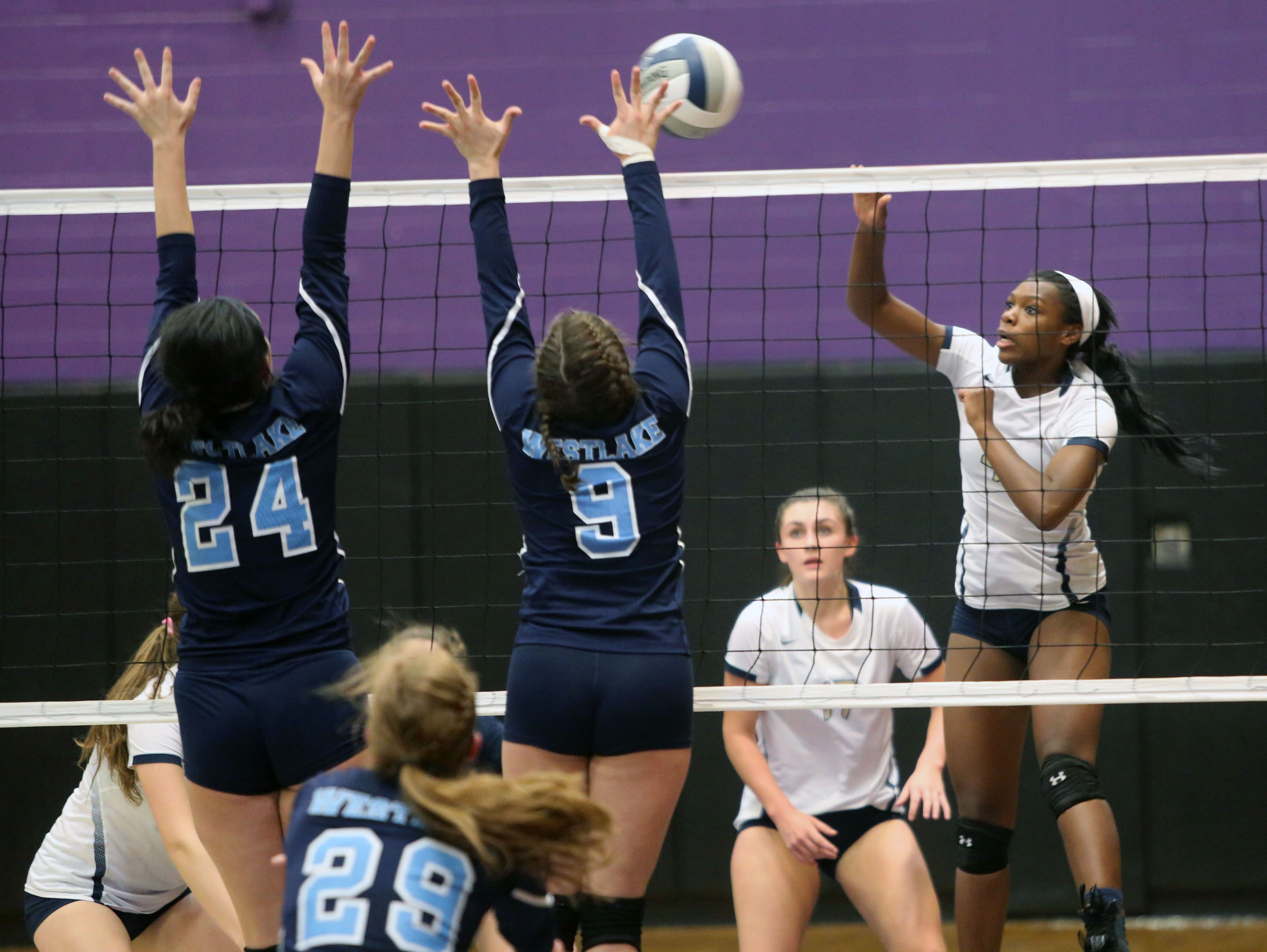 Lourdes' Rebecca Townes hits the ball toward Westlake''s Kelly Martin and Antonia Perino during the Section 1 Class B volleyball final at John Jay High School in Cross River, Nov. 5, 2016.