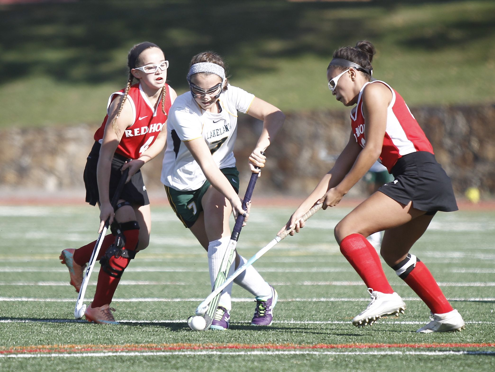 Lakeland's Caroline Cahill (7) splits the Red Hook defense during their 8-0 win in the Class B regional championship field hockey game at Valhalla High School on Saturday, November 5, 2016.