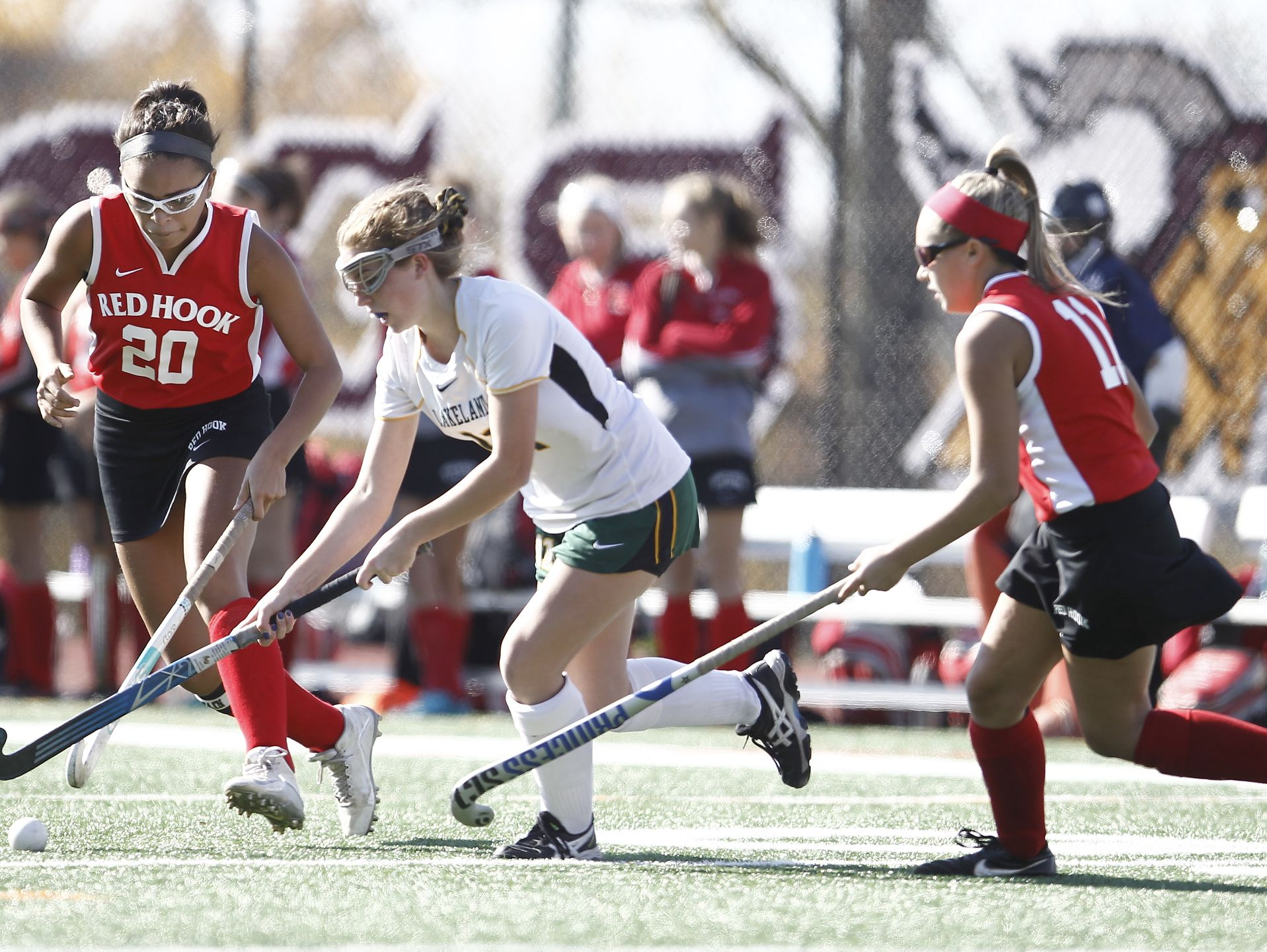 Lakeland's Julianna Cappello (11) splits the Red Hook defense at mid-field during their 8-0 win in the Class B regional championship field hockey game at Valhalla High School on Saturday, November 5, 2016.