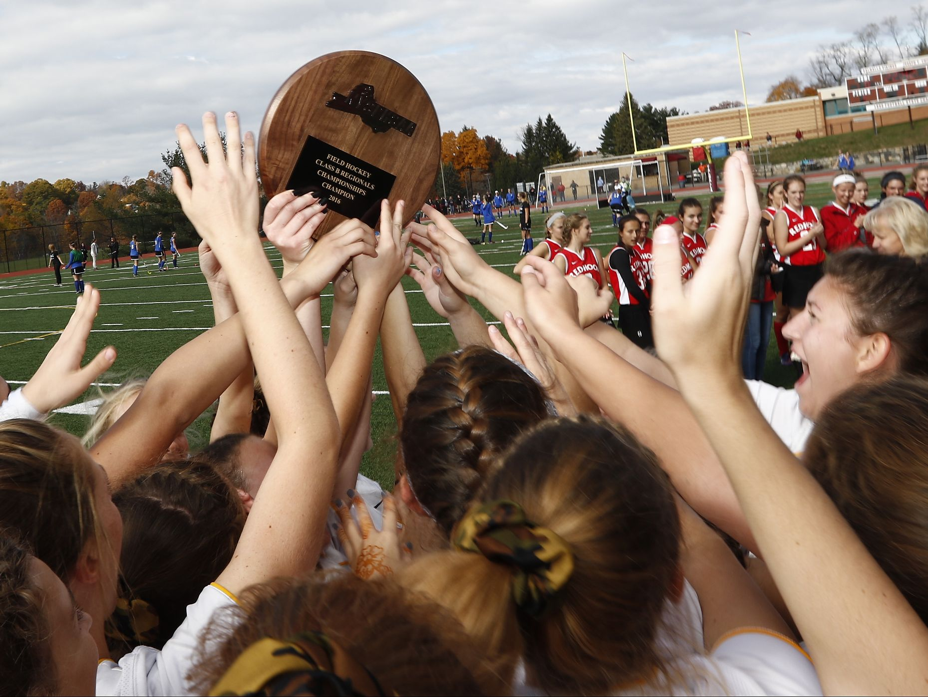 Lakeland celebrates their 8-0 win over Red Hook in the Class B regional championship field hockey game at Valhalla High School on Saturday, November 5, 2016.