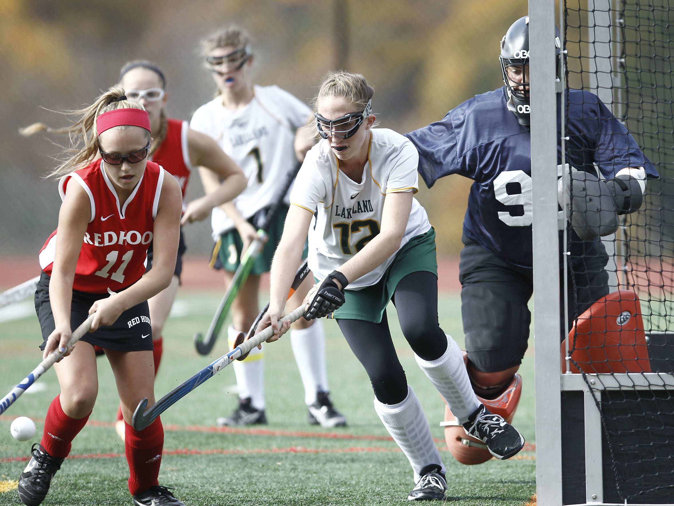 Lakeland's Lindsay Palmaffy (12) works foir a rebound in front of the goal during their 8-0 win over Red Hook in the Class B regional championship field hockey game at Valhalla High School on Saturday, November 5, 2016.