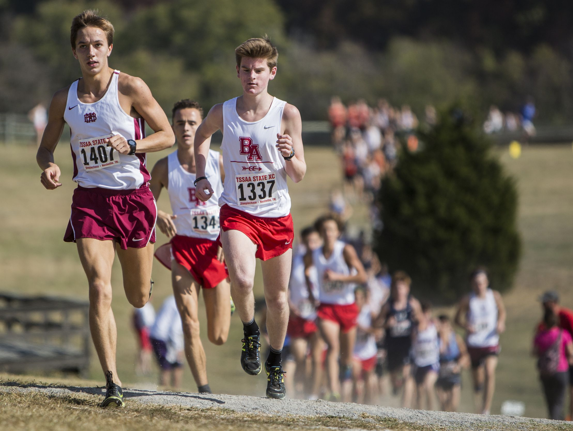 Will Peters of Montgomery Bell and Carter Cheeseman of Brentwood Academy lead the pack during the Division II-AA boys 2016 TSSAA State Cross Country Championship at Percy Warner Park.