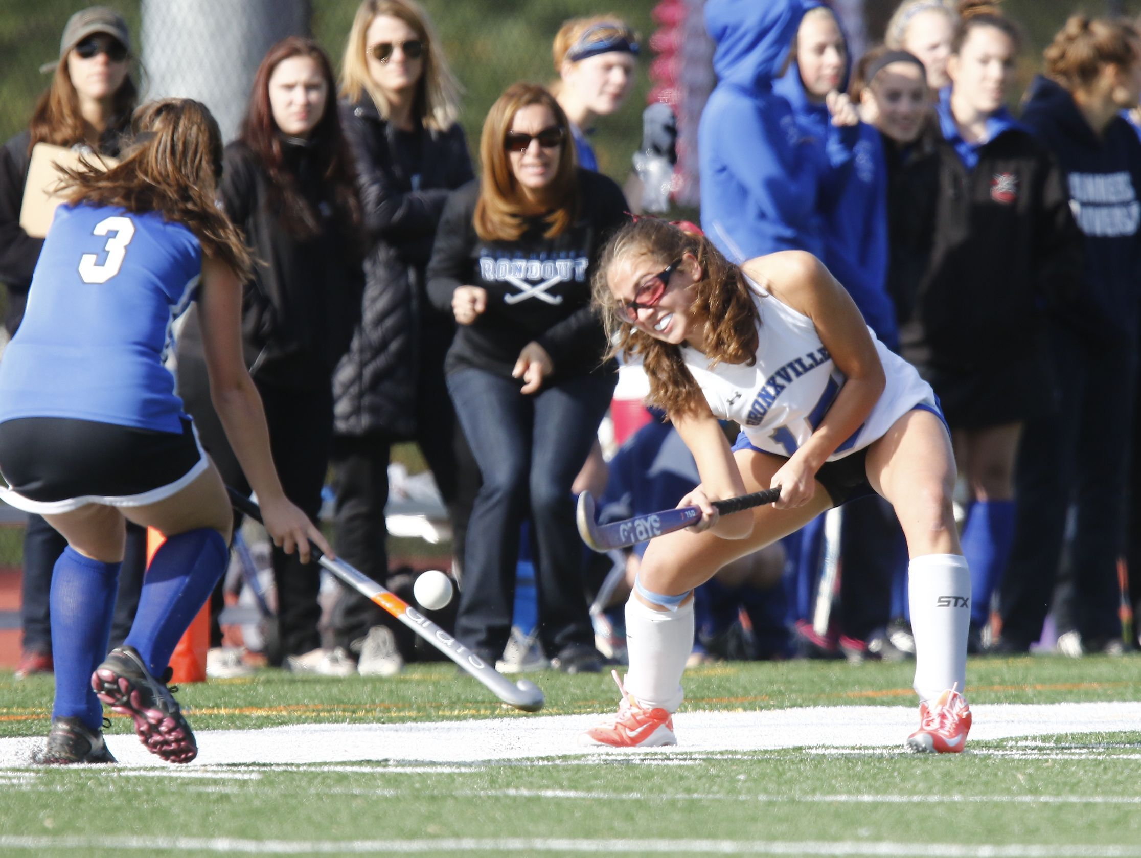 Bronxville's Claire Kramer (15) feeds a pass up the side-line during their 2-0 win over Roundout Valley in the Class C regional championship field hockey game at Valhalla High School on Saturday, November 5, 2016.