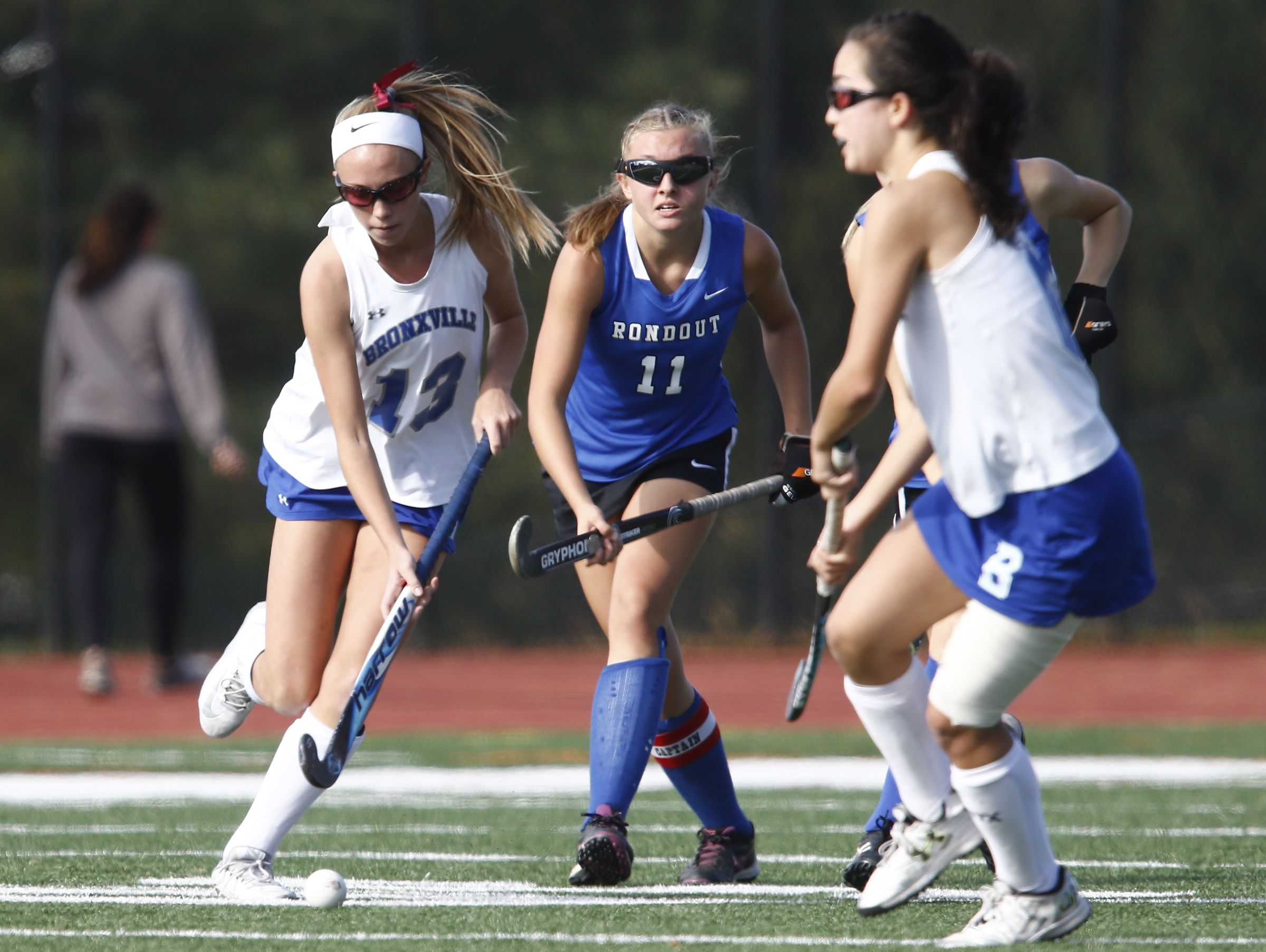 Bronxville Fiona Jones (13) works the ball around a Roundout Valley defender durubg their 2-0 win over Roundout Valley in the Class C regional championship field hockey game at Valhalla High School on Saturday, November 5, 2016.