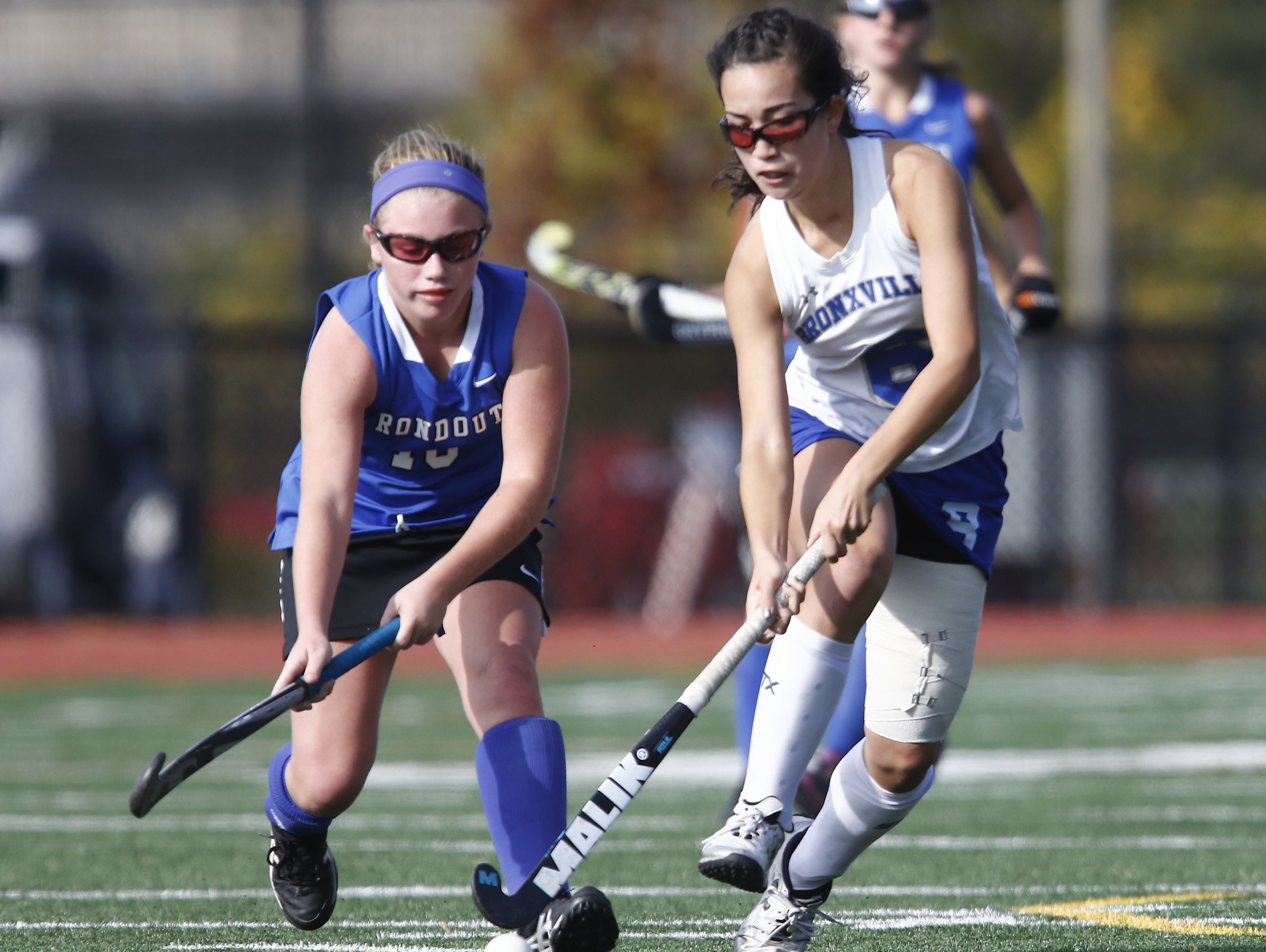 Bronxville's Hannah Weirens (15)works past a Roundout Valley defender during their 2-0 win over Roundout Valley in the Class C regional championship field hockey game at Valhalla High School on Saturday, November 5, 2016.