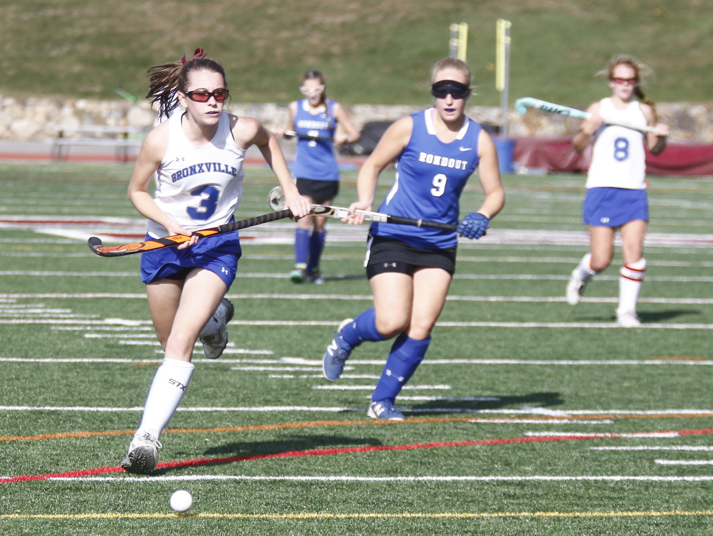 Bronxville's Mia Bettino (3) works past Roundout Valley's Makaylah Mutz (9) in the Class C regional championship field hockey game at Valhalla High School on Saturday, November 5, 2016.