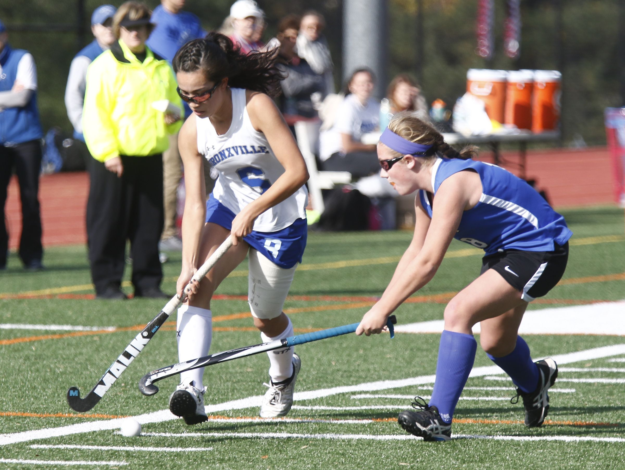 Bronxville's Hannah Weirens (15) works the ball up the side-line during their 2-0 win over Roundout Valley in the Class C regional championship field hockey game at Valhalla High School on Saturday, November 5, 2016.
