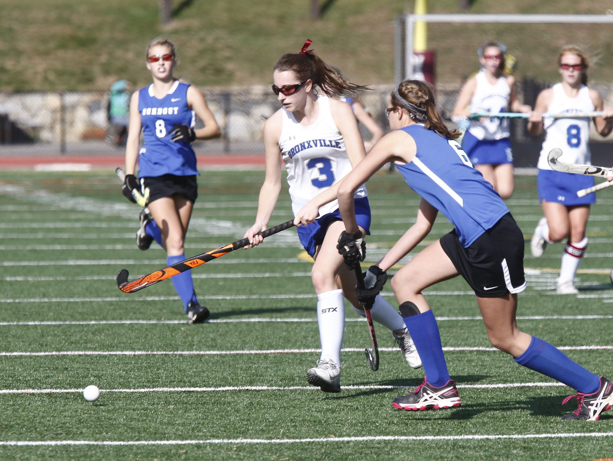 Bronxville's Mia Bettino (3) works past Roundout Valley's Paige Bogart (6) in the Class C regional championship field hockey game at Valhalla High School on Saturday, November 5, 2016.