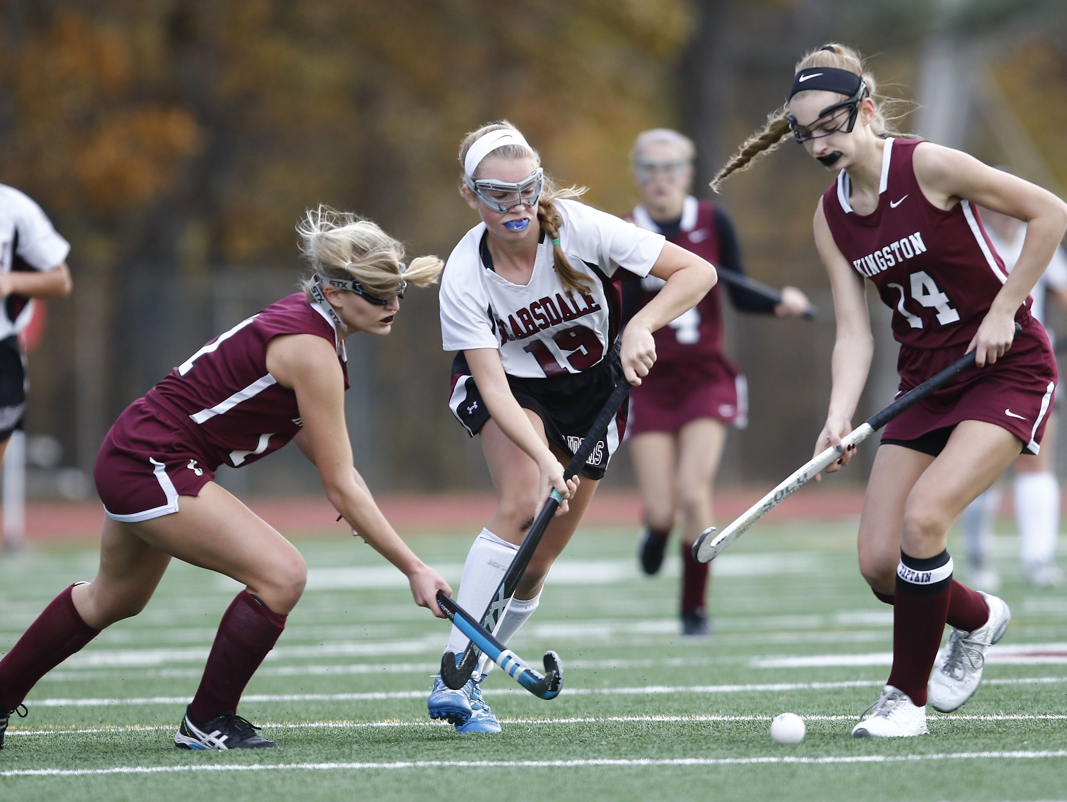 Scarsdale's Sophia Franco (19) splits the Kingston defense during their 5-0 win in the Class A regional championship field hockey game at Valhalla High School on Saturday, November 5, 2016.