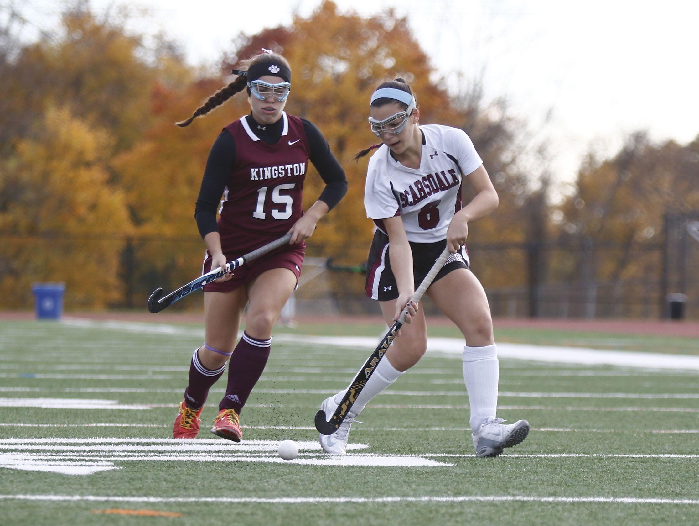 Scarsdale's Emma Schwartz (8)works past Kingston's Angela Van Pelt (15) during their 5-0 win in the Class A regional championship field hockey game at Valhalla High School on Saturday, November 5, 2016.