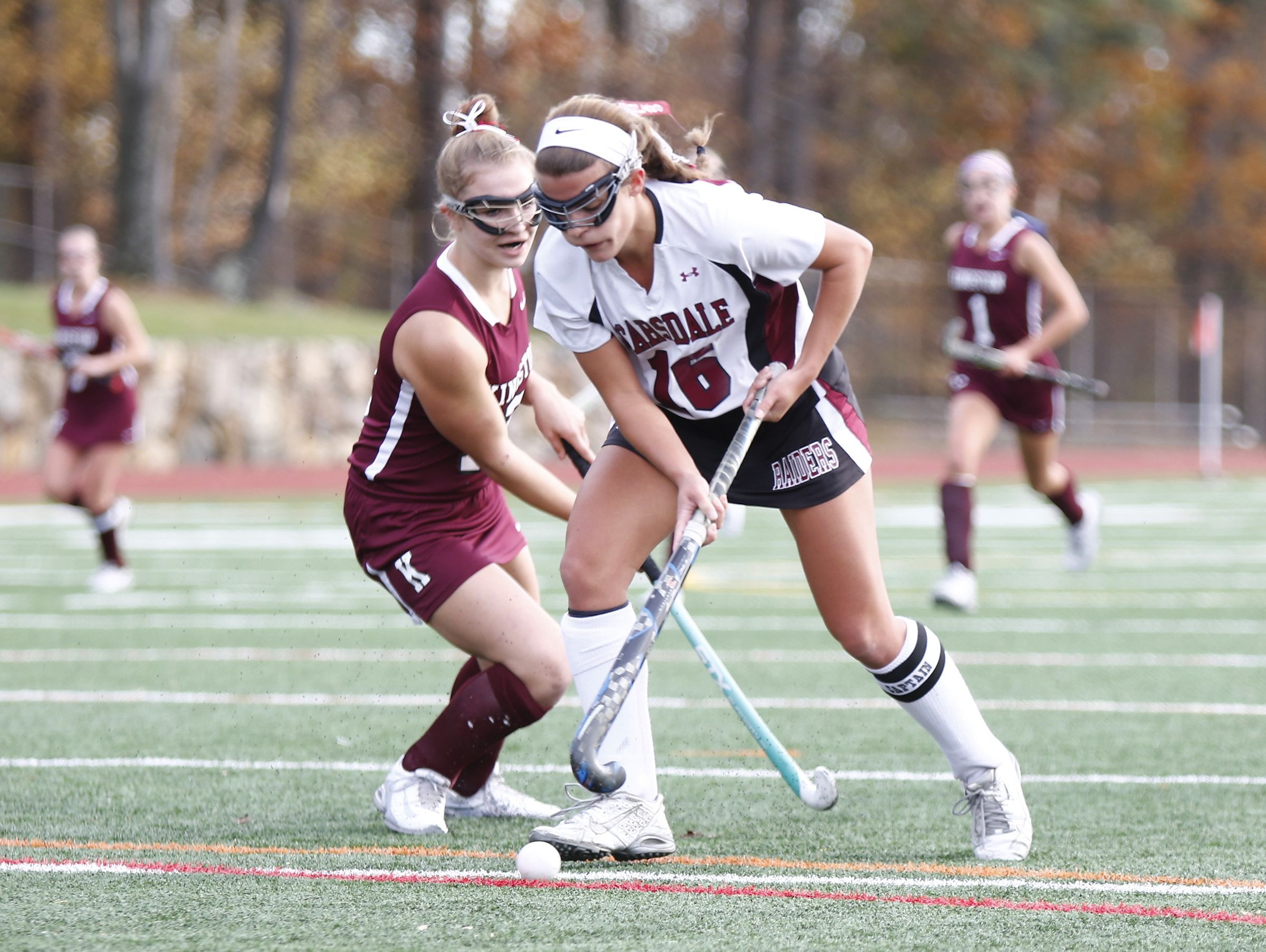 Scarsdale's Erin Nicholas (16 works past a Kingston defender during their 5-0 win in the Class A regional championship field hockey game at Valhalla High School on Saturday, November 5, 2016.