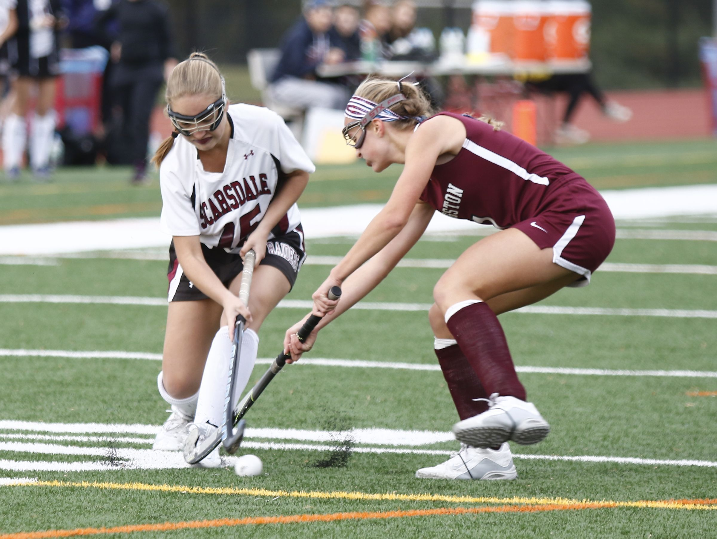 Scarsdale's Paige Panessa (15) works past a Kingston defender during their 5-0 win in the Class A regional championship field hockey game at Valhalla High School on Saturday, November 5, 2016.
