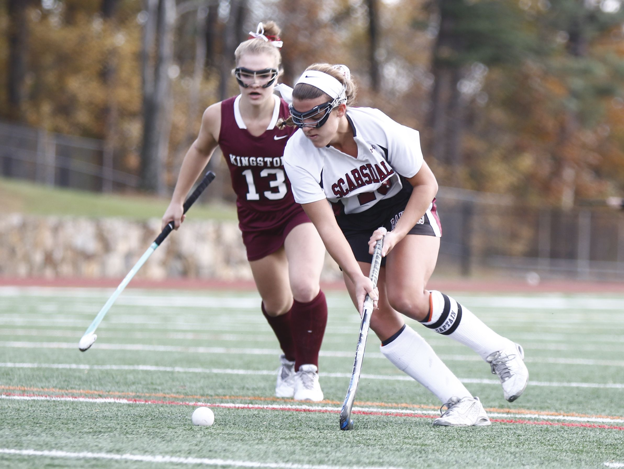 Scarsdale's Erin Nicholas (16) works past a Kingston's Juliana Sickler (3) during their 5-0 win in the Class A regional championship field hockey game at Valhalla High School on Saturday, November 5, 2016.