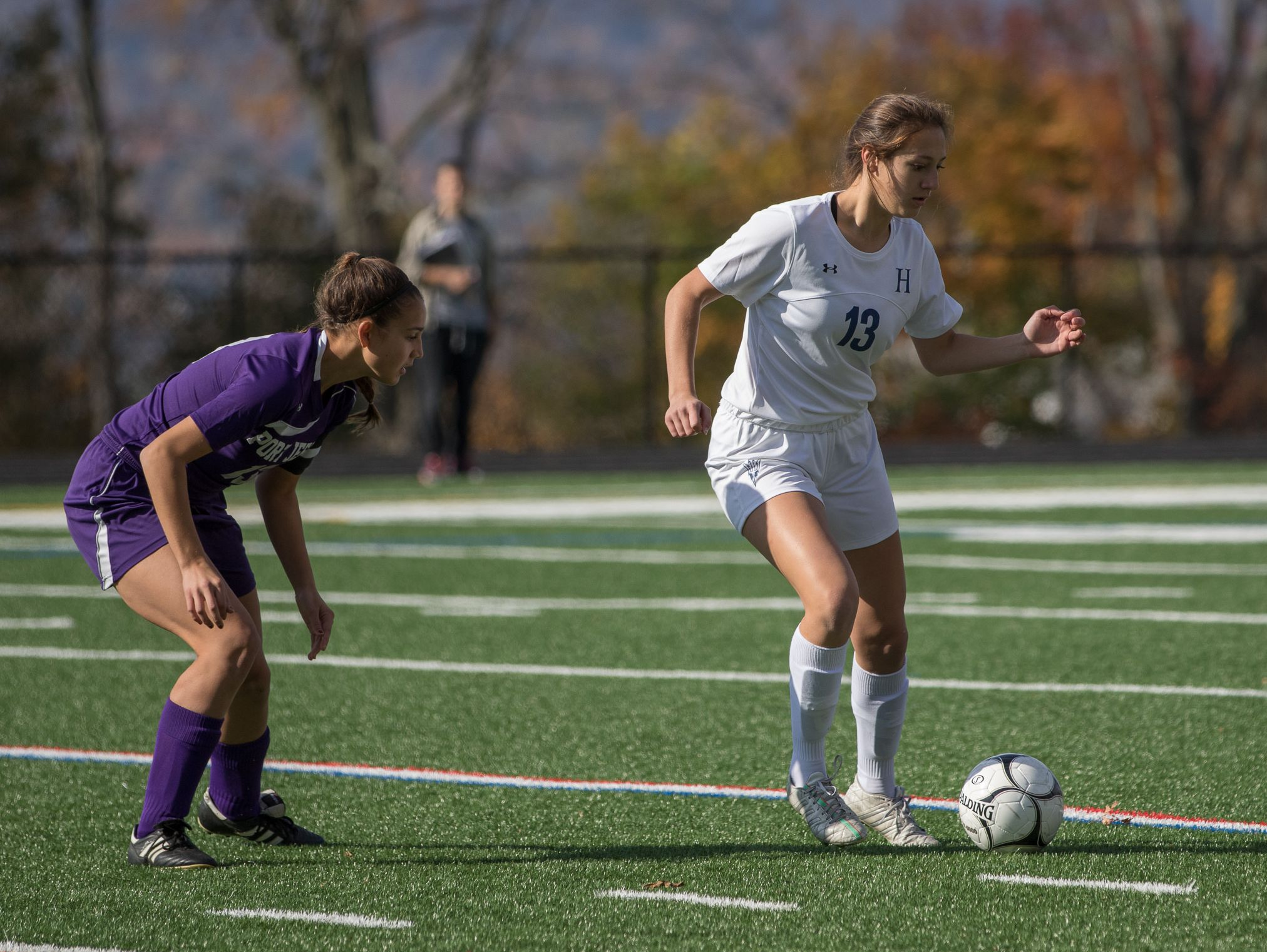 Allison Chiera, right, of Haldane tries to get past Corinne Scannell of Port Jefferson during a Class C girls soccer regional final on Saturday at Sleepy Hollow High School.