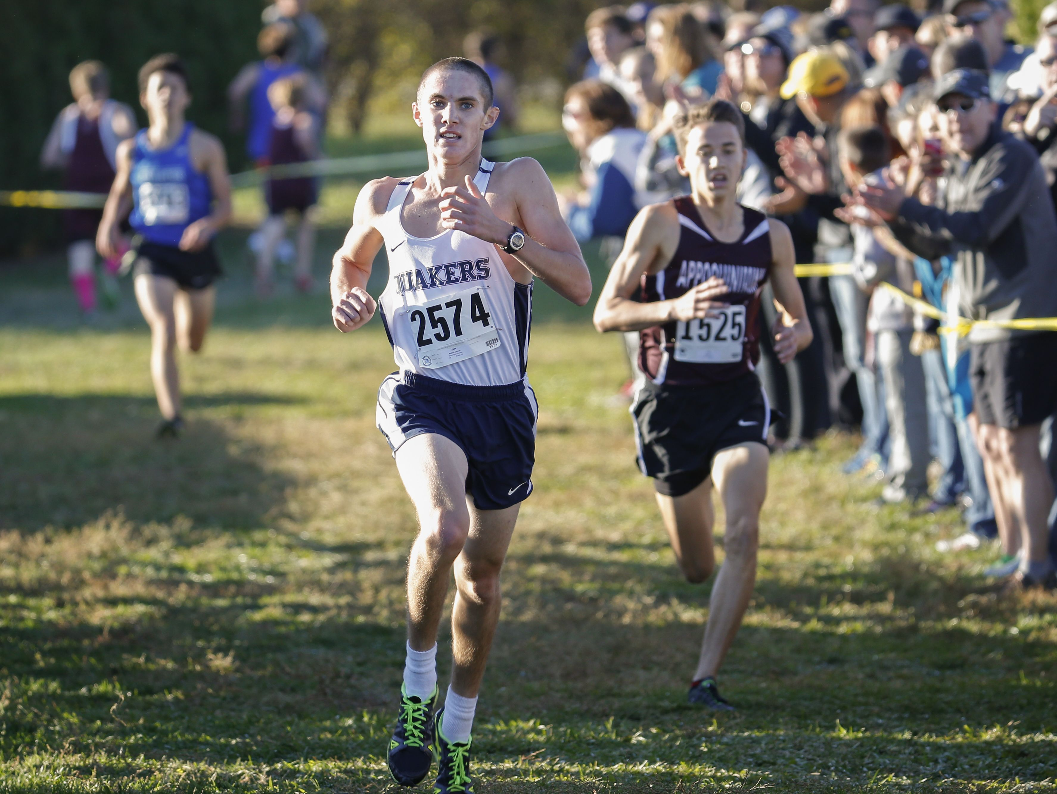 Winner Connor Nisbet of Wilmington Friends leads second place finisher Vail Freed of Appoquinimink in the final yards at the finish line of the New Castle County cross country championships Saturday at Winterthur.