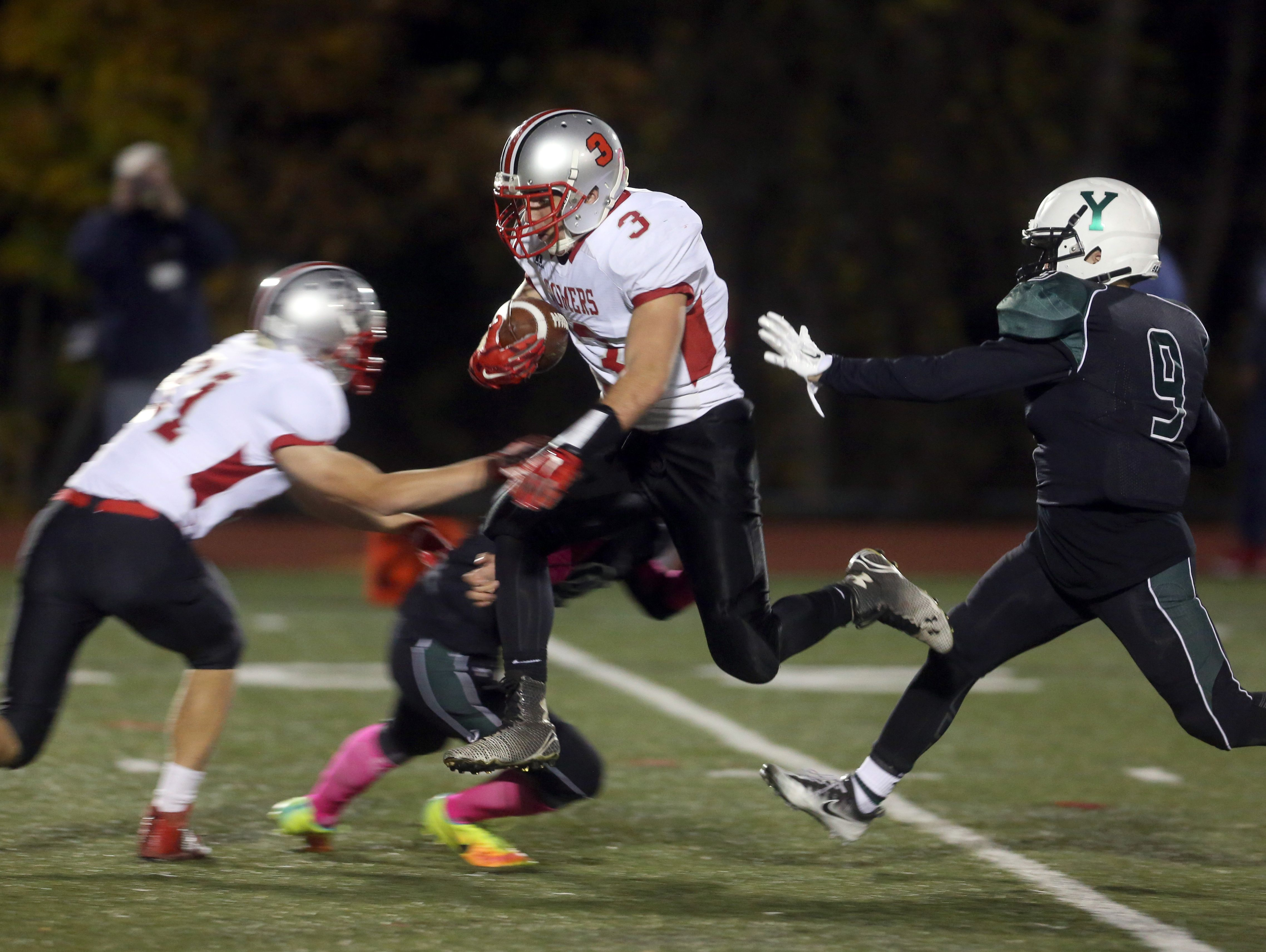 Matthew Pires of Somers gets airborne on his way to a 60-yard punt return against Yorktown during the Section 1 Class A football championship at Mahopac High School Nov. 6, 2016.