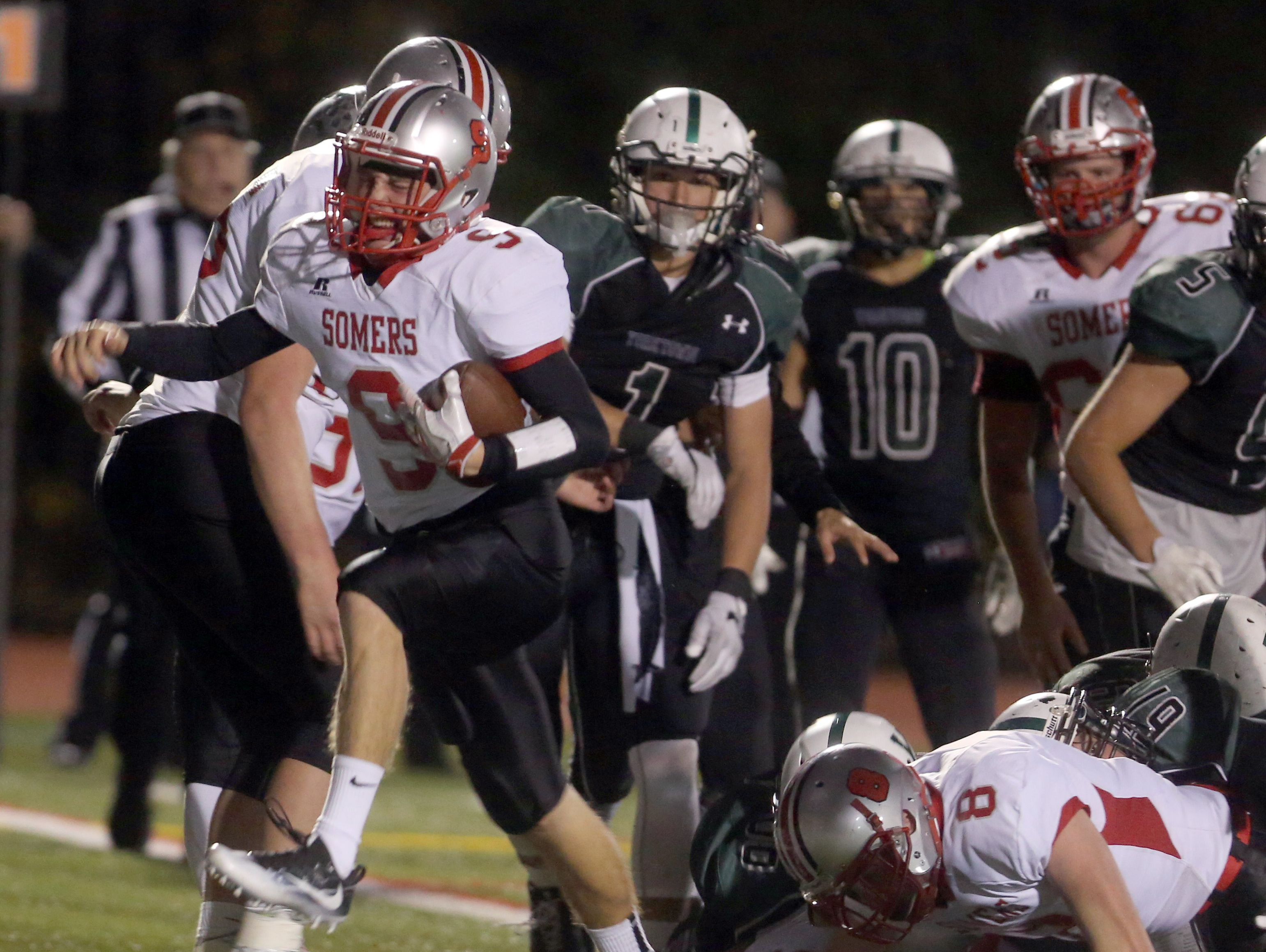 Somers quarterback Kevin Olifiers scores on a keeper against Yorktown during the Section 1 Class A football championship at Mahopac High School Nov. 6, 2016.