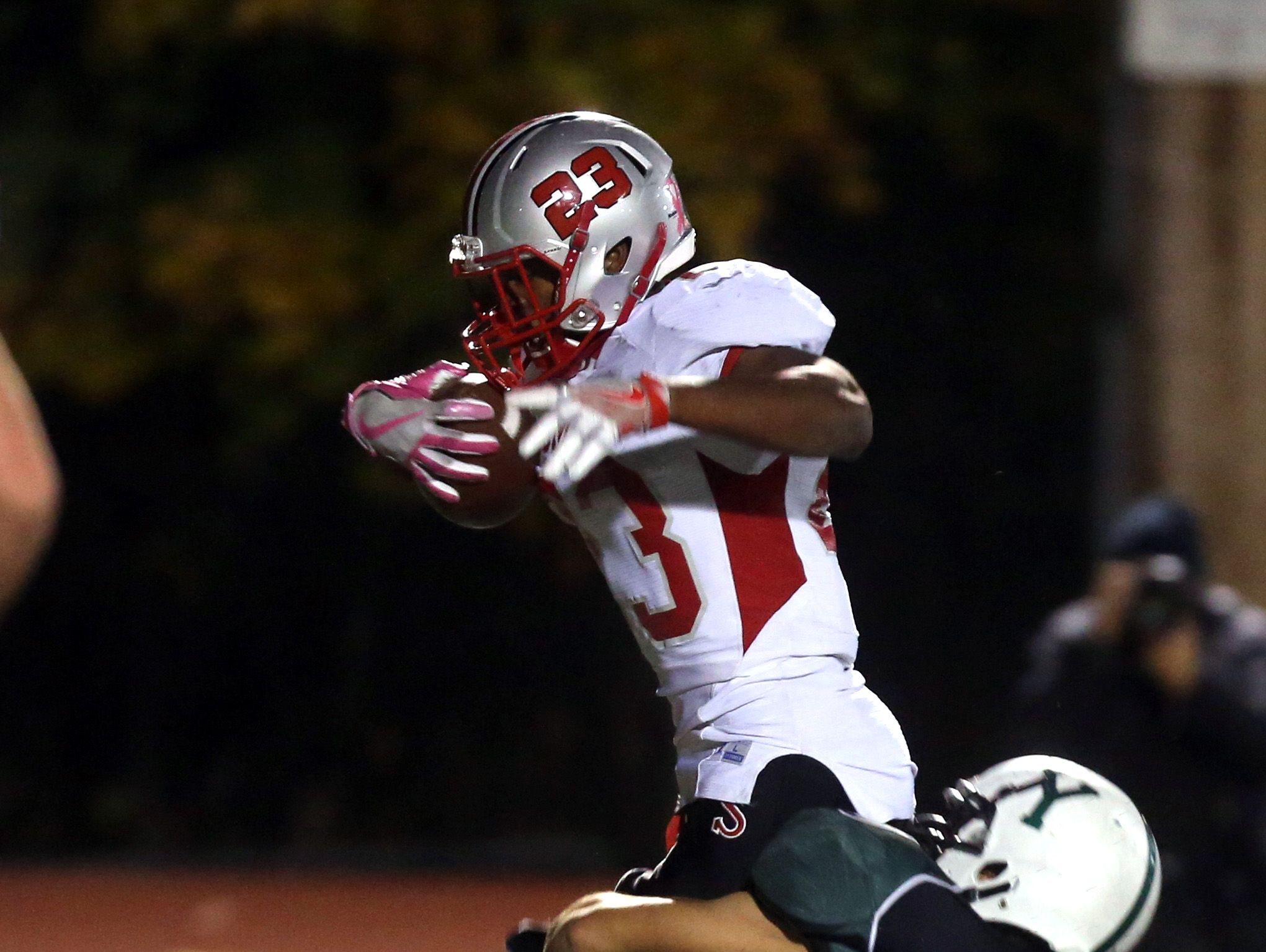 Messiah Horne of Somers takes Yorktown's Dominick Cijoffi into the end zone as he scores during the Section 1 Class A football championship at Mahopac High School Nov. 6, 2016.