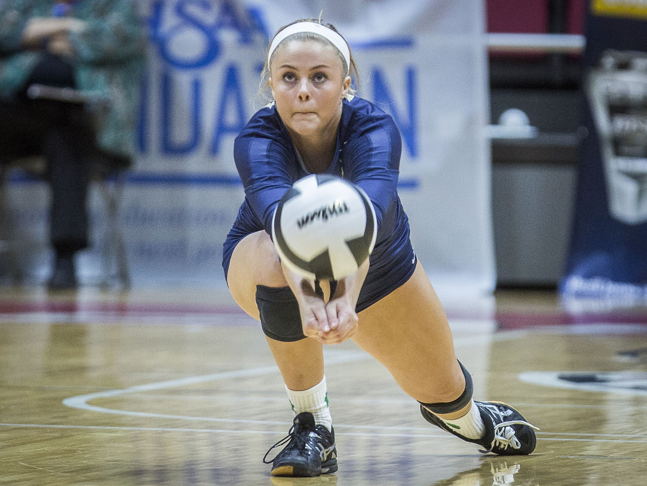 Cathedral's Payton White passes during their state final match against Crown Point at Worthen Arena Saturday.