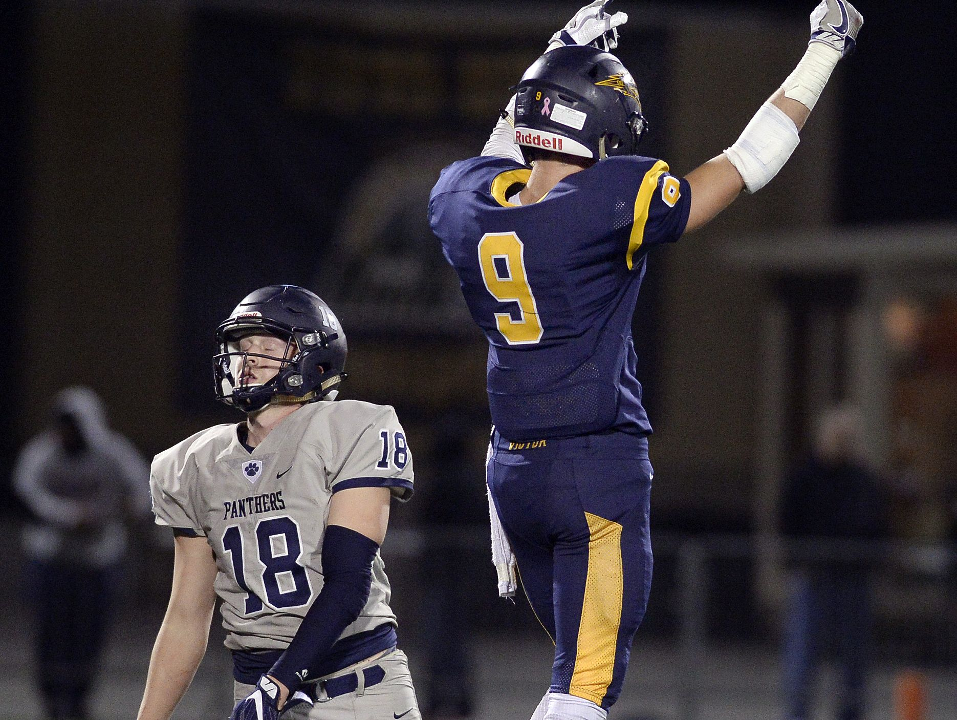 Victor's Andrew Russell (9) celebrates after stopping Pittsford's Colby Barker on fourth down.