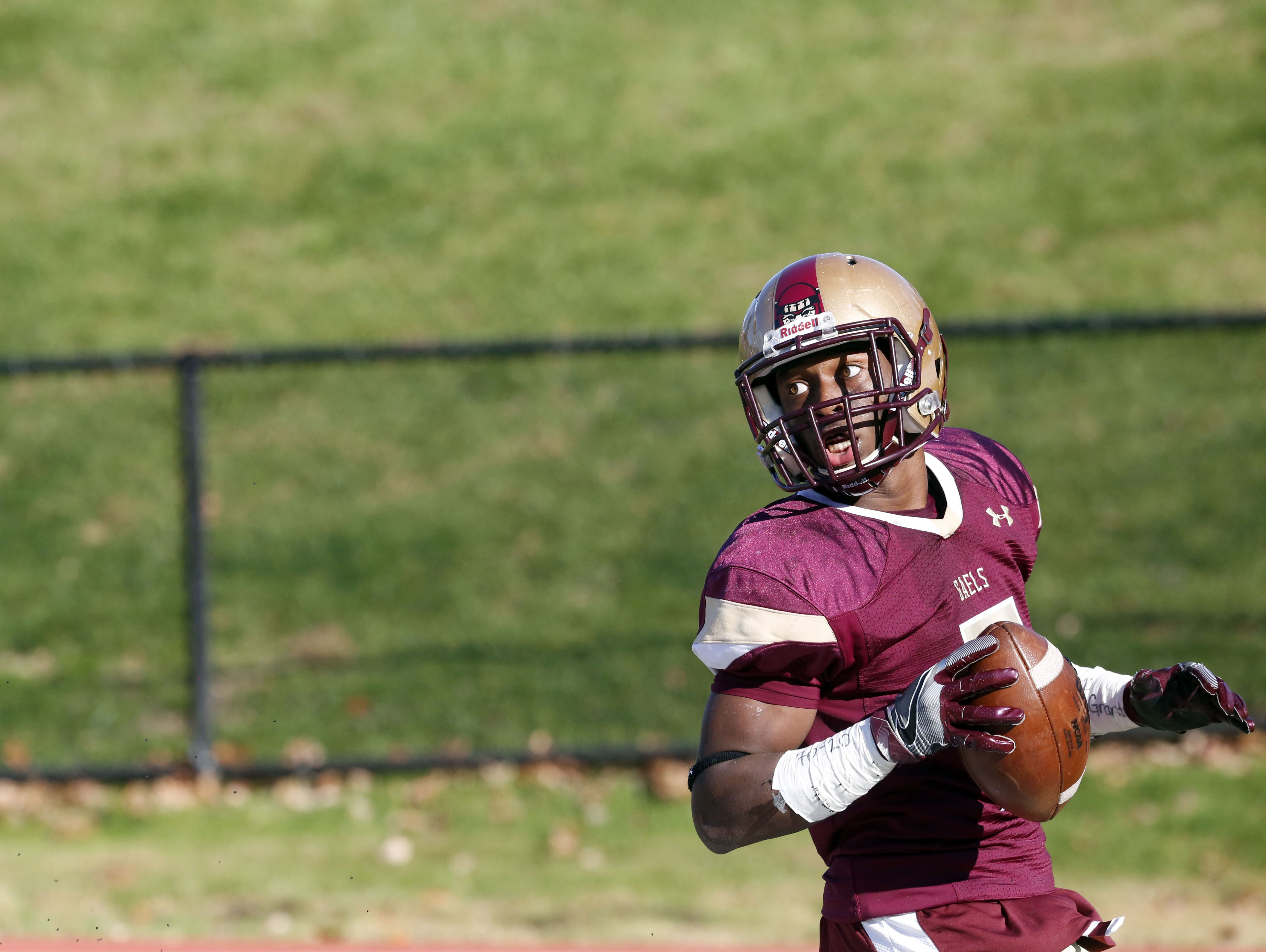 Iona Prep's Ki'Shyne Shipmon looks back after scoring a touchdown against Fordham Prep in the quarterfinals of the Catholic High School Football League Nov. 6, 2016 at Iona Prep in New Rochelle. Iona Prep won, 41-0.