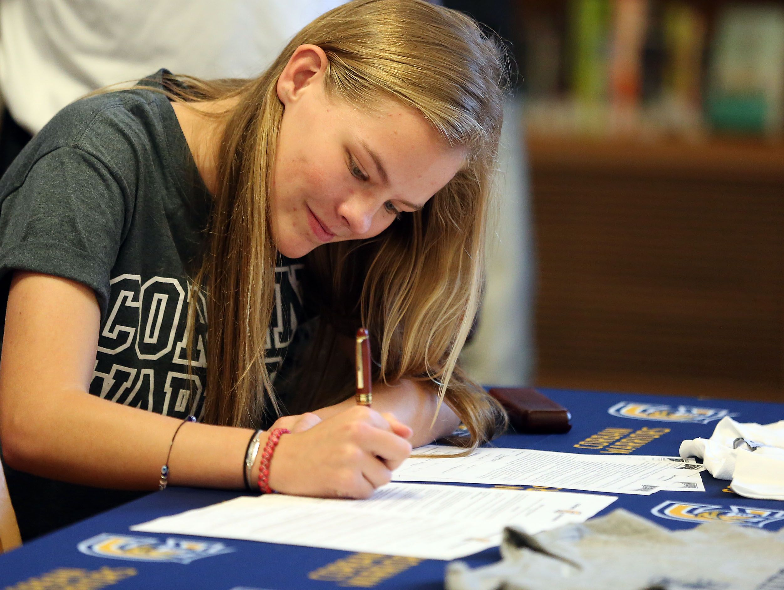 South Salem senior Hannah Hersh signs a letter of intent to play soccer at Corban University during a signing ceremony on Tuesday, Nov. 8, 2016, at South Salem High School.