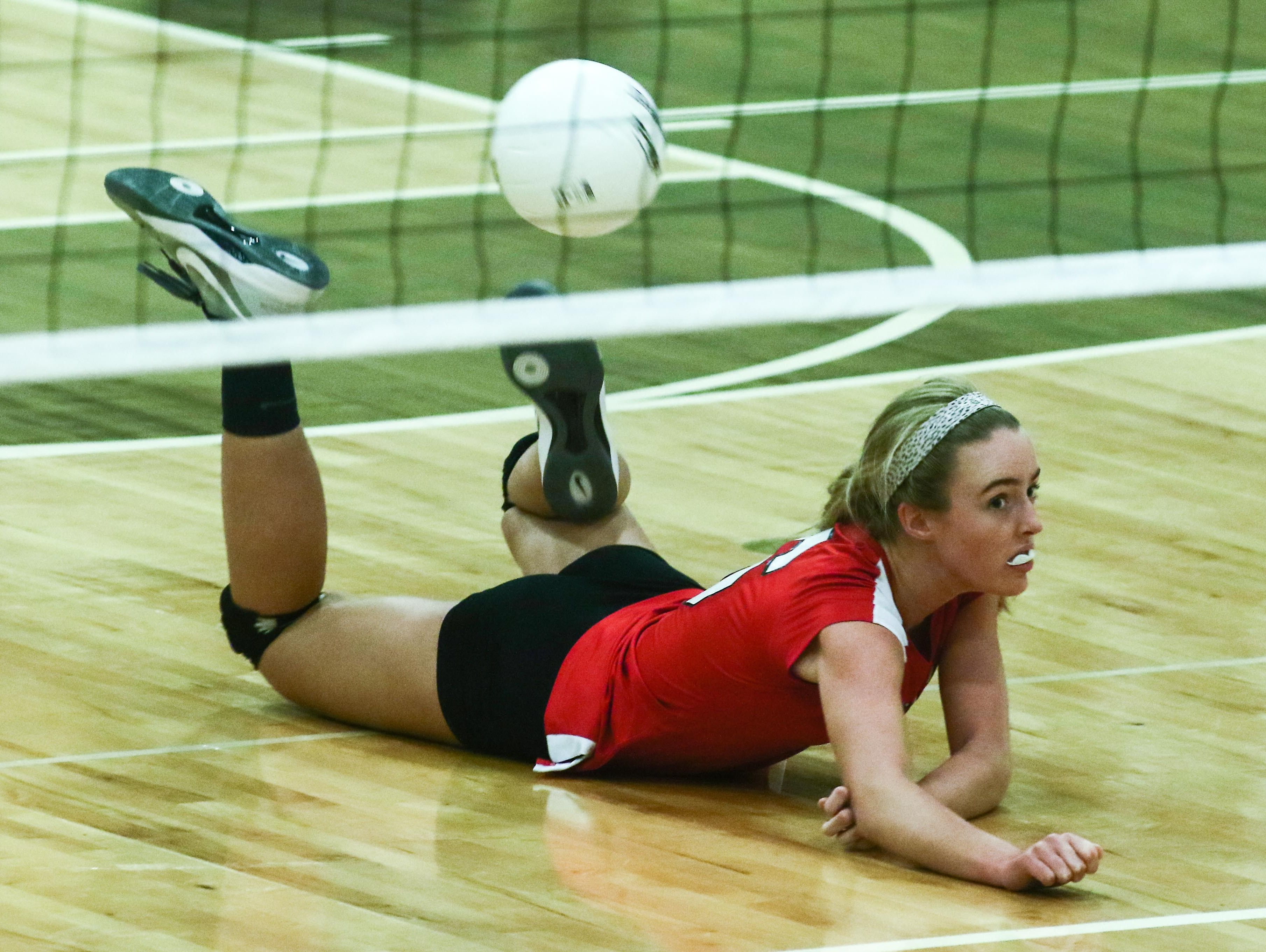 Ursuline's Corinne Furey (6) dives to save the ball during a DIAA Girls Volleyball quarterfinals match between Padua and Ursuline on Tuesday at St. Mark's High School in Wilmington.