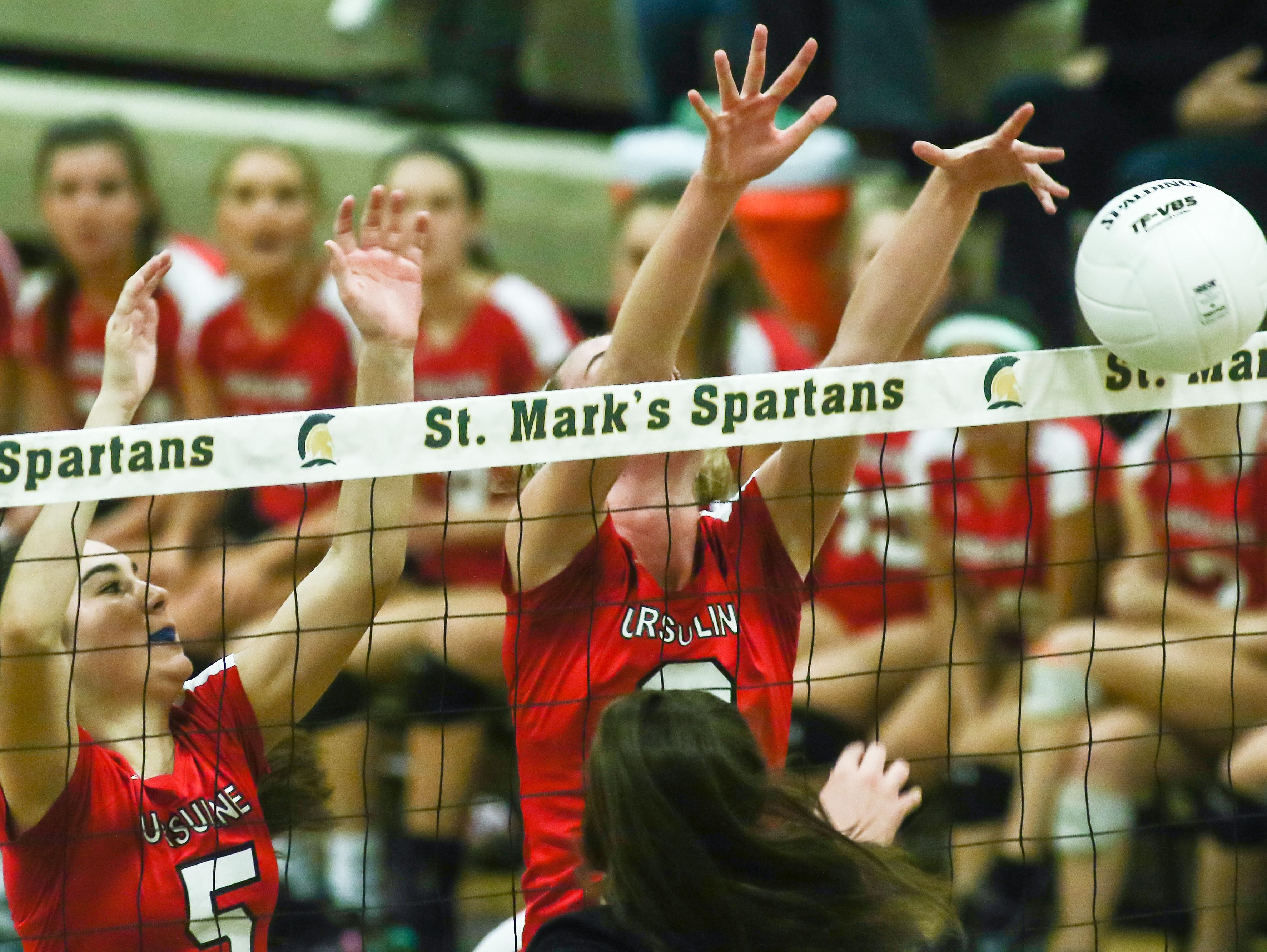 Ursuline's Corinne Furey (6), right, jumps up to block a spike during a DIAA Girls Volleyball quarterfinals match between Padua and Ursuline on Tuesday at St. Mark's High School in Wilmington.
