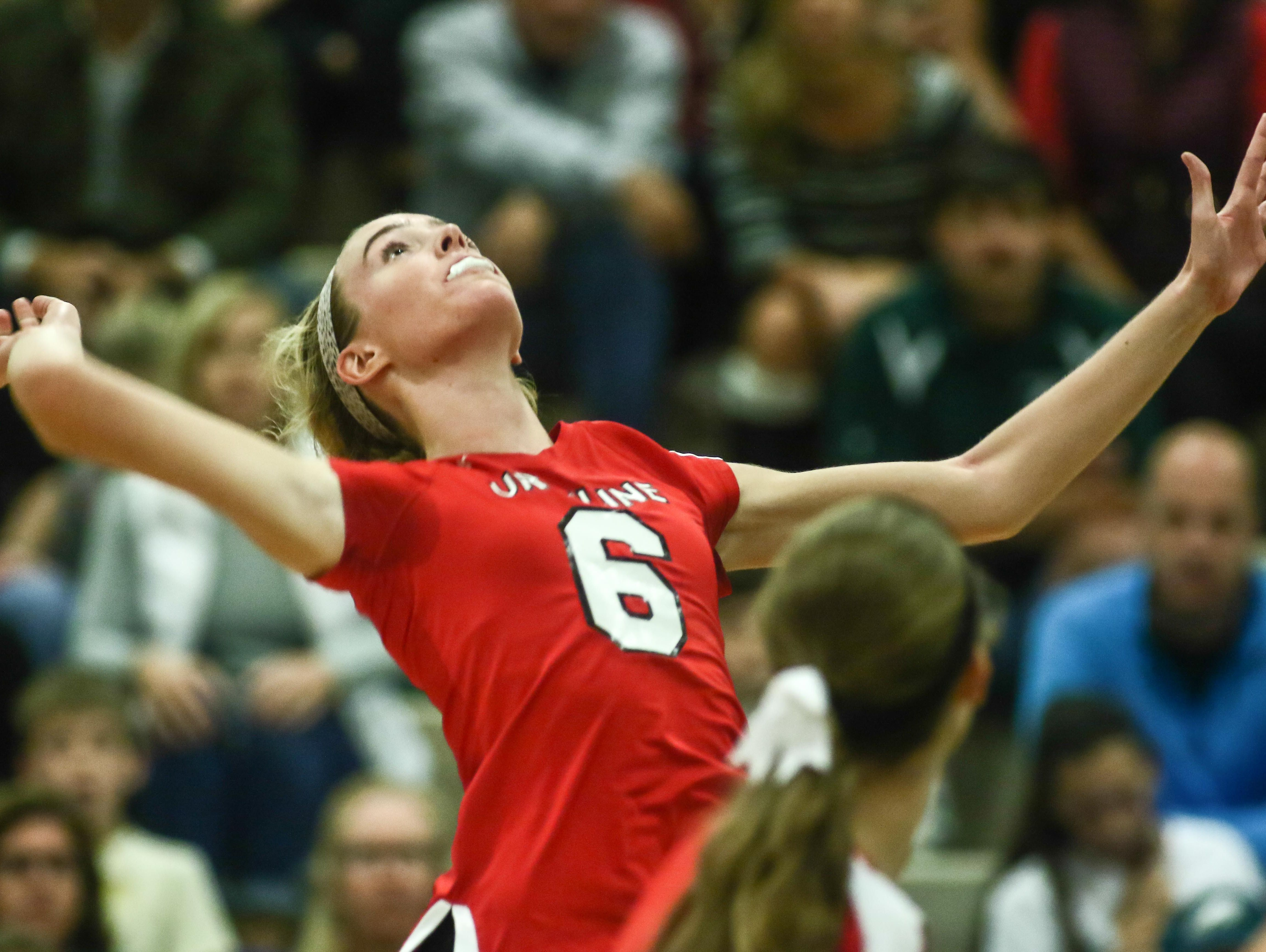 Ursuline's Corinne Furey (6) returns a serve during a DIAA Girls Volleyball quarterfinals match between Padua and Ursuline on Tuesday at St. Mark's High School in Wilmington.