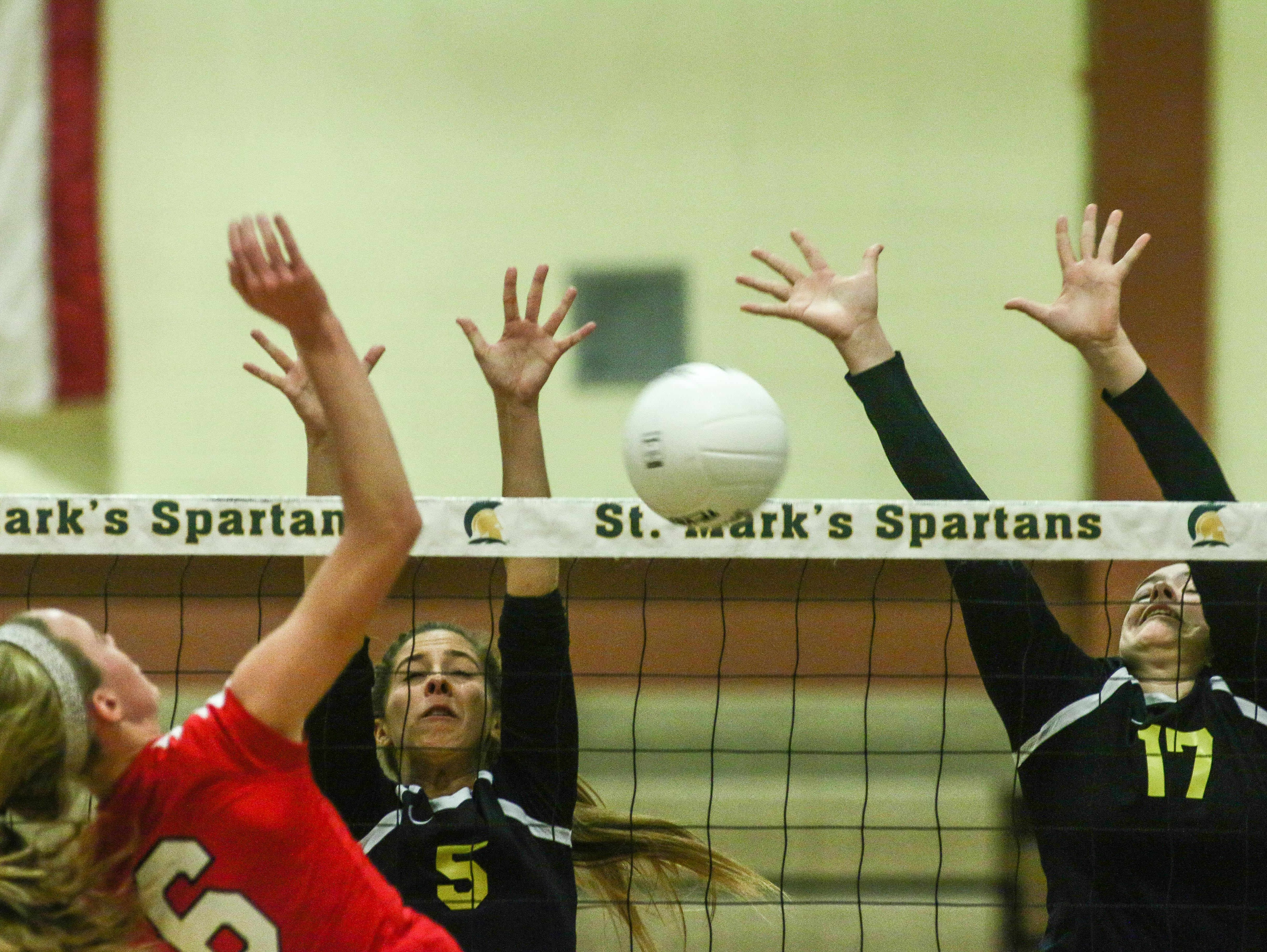 Ursuline's Corinne Furey (6) spikes the ball past the Padua defense during a DIAA Girls Volleyball quarterfinals match between Padua and Ursuline on Tuesday at St. Mark's High School in Wilmington.