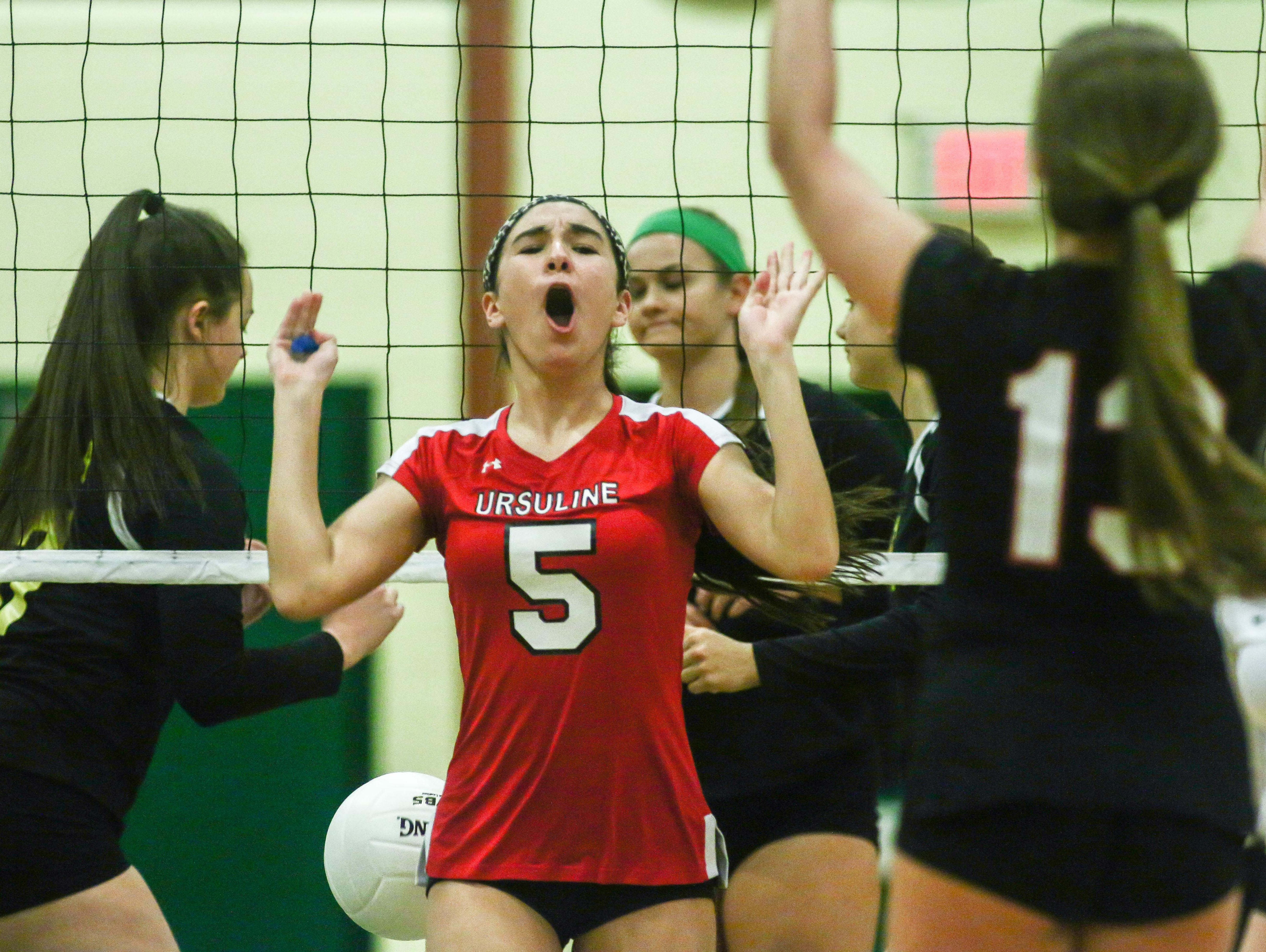Ursuline's Kylie Nocket (5) celebrates with her teammates during a DIAA Girls Volleyball quarterfinals match between Padua and Ursuline on Tuesday at St. Mark's High School in Wilmington.