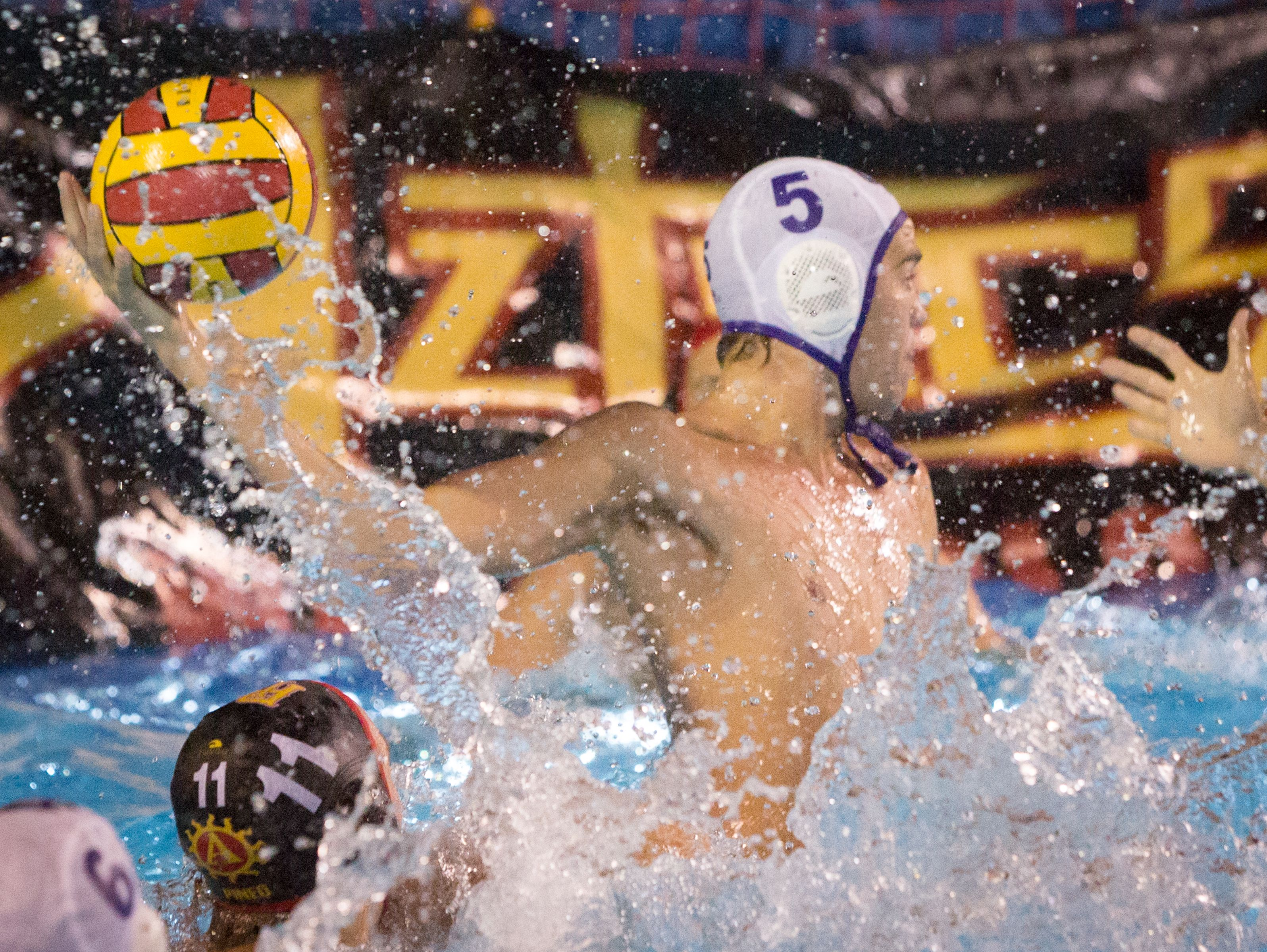 Rancho Cucamonga's Hunter Schoeller, who led both teams with 11 goals Tuesday, takes a shot in his team's 14-12 win over Palm Desert.