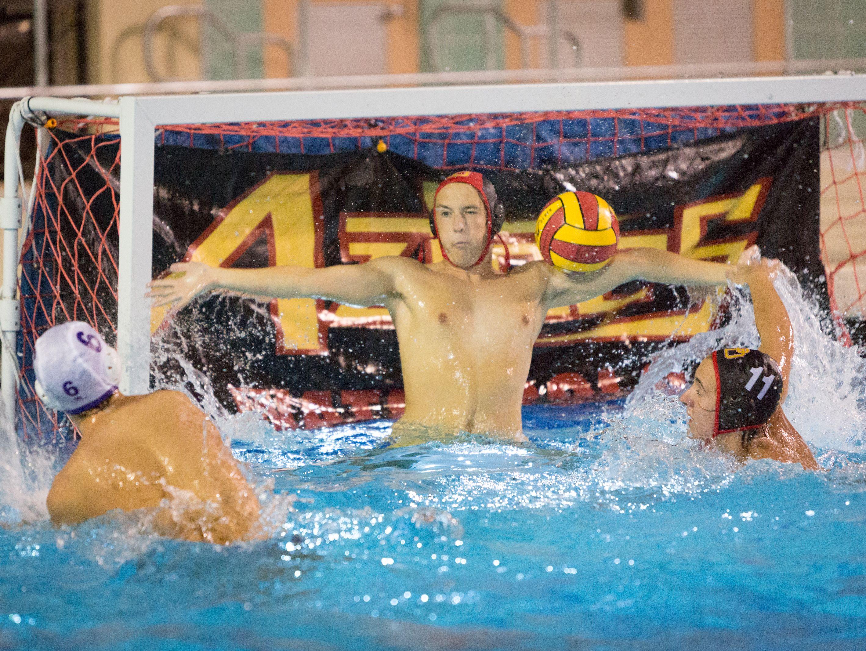 Palm Desert goalkeeper Zane Rhodes blocks the ball from Austin Schoeller's shot Tuesday in the teams' CIF first round match.