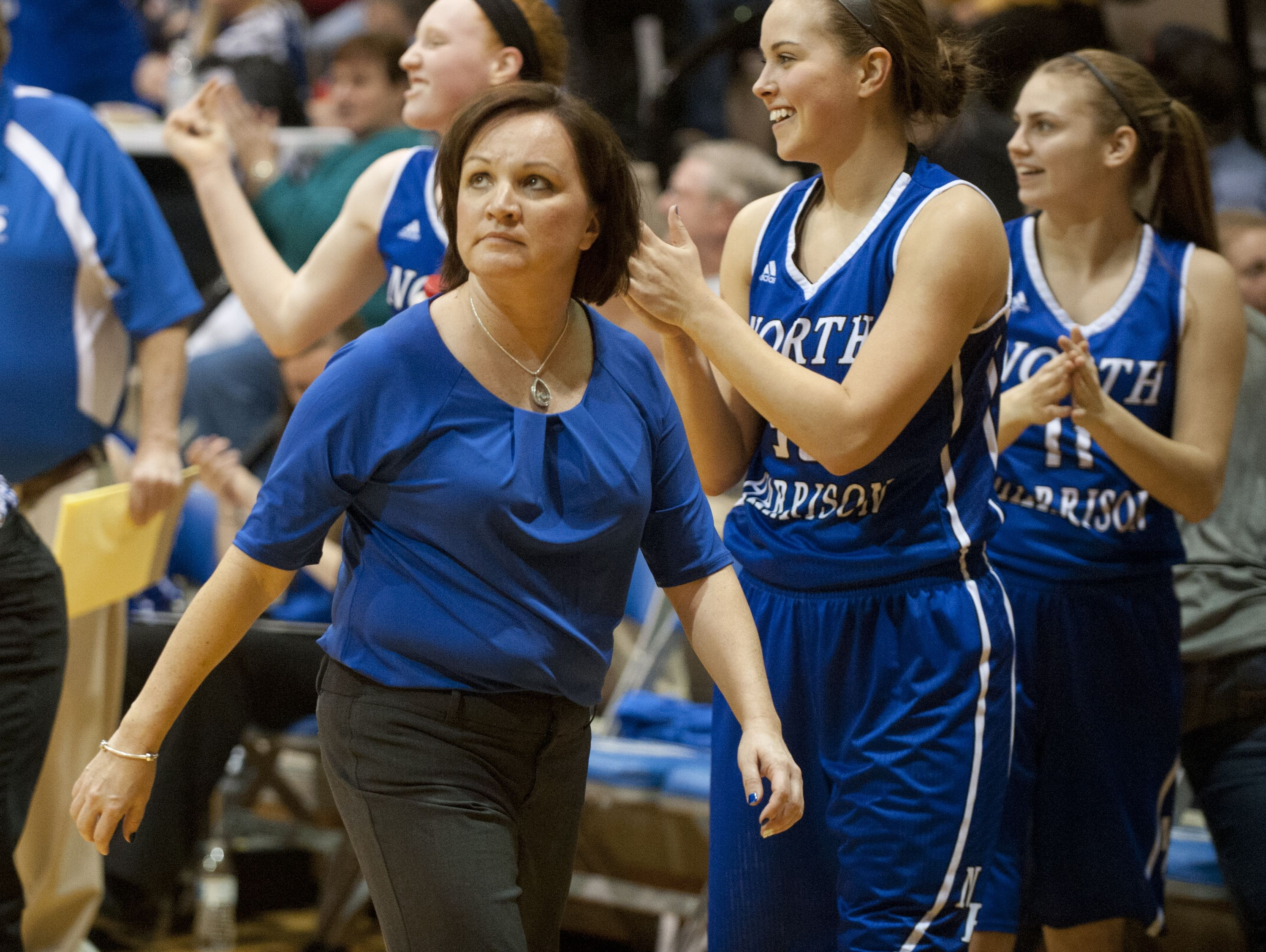 North Harrison coach Missy Voyles looks up at the clock in the closing seconds of her 200th win.