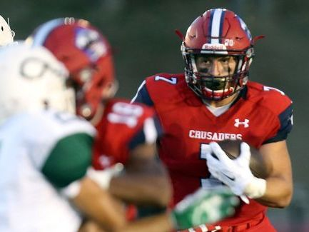 Antonio Giannico looks for running room during Stepinac's season-opening win over visiting Cornwall on Sept. 9, 2016.