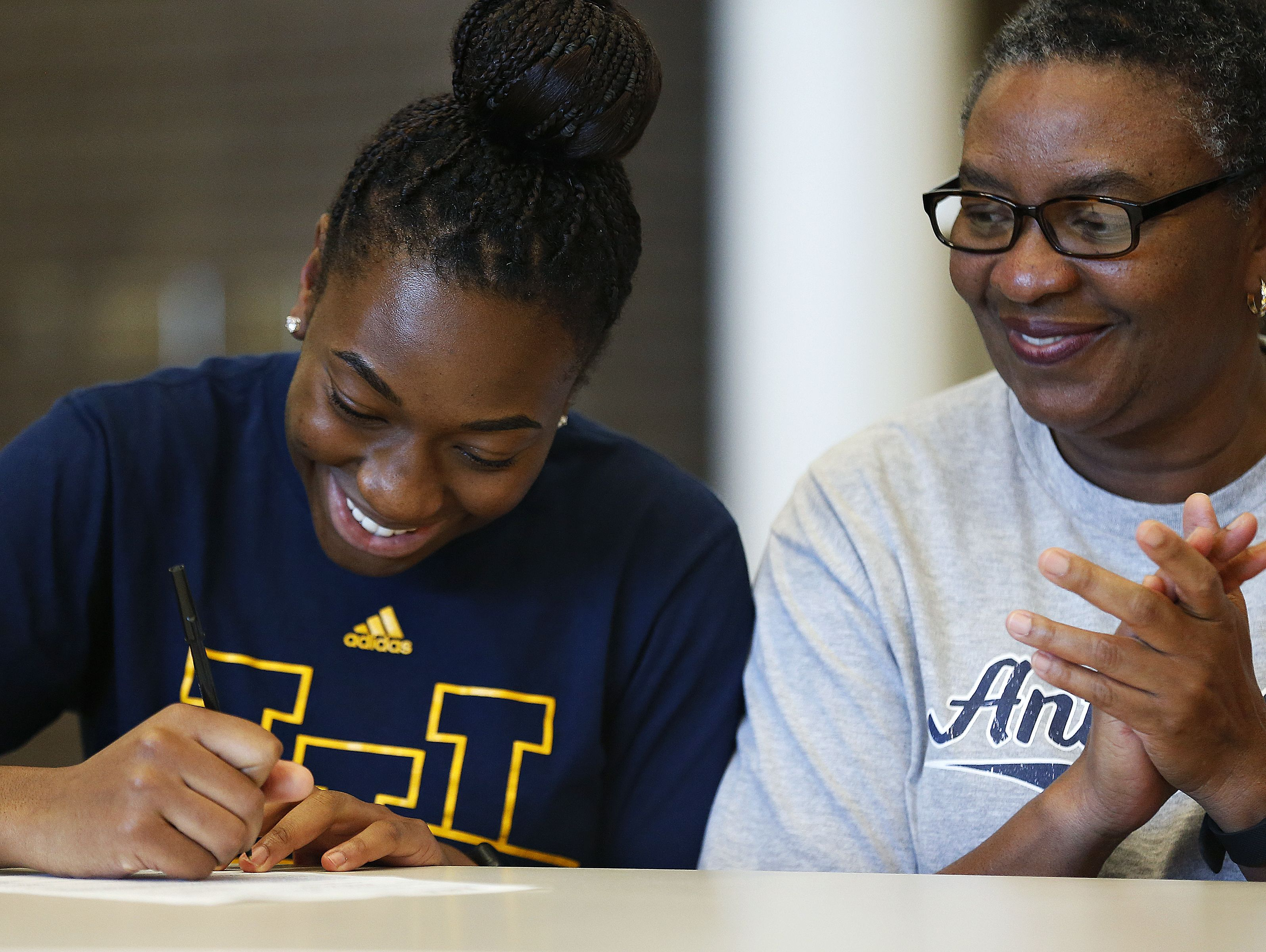 Jordan Sanders (left) signs a national letter of intent to the University of California-Irvine during a National Signing Day event held for Chiefs athletes at Kickapoo High School in Springfield, Mo. on Nov. 9, 2016.