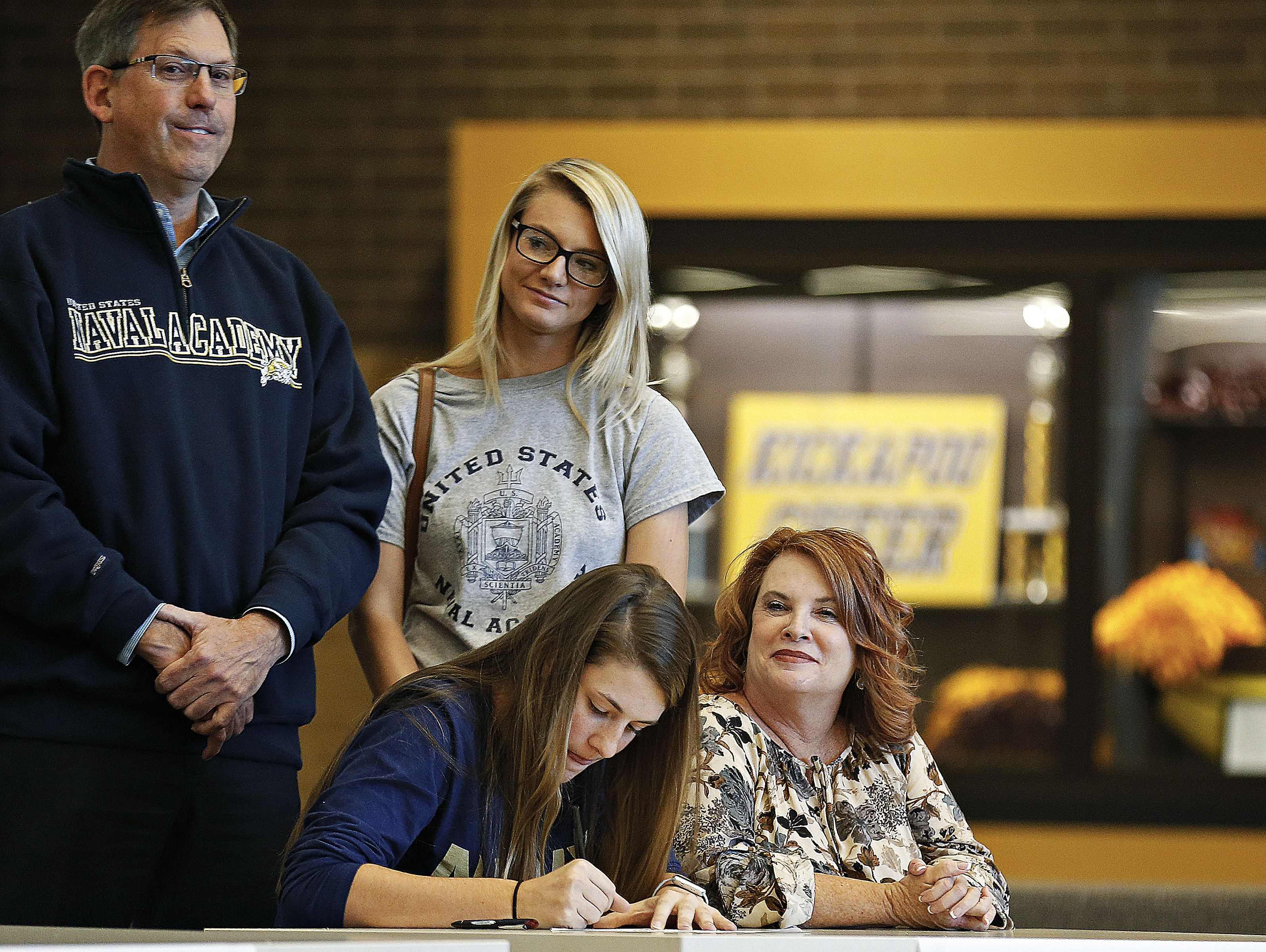 Ari Acuff signs a national letter of intent to the Naval Academy during a National Signing Day event held for Chiefs athletes at Kickapoo High School in Springfield, Mo. on Nov. 9, 2016.