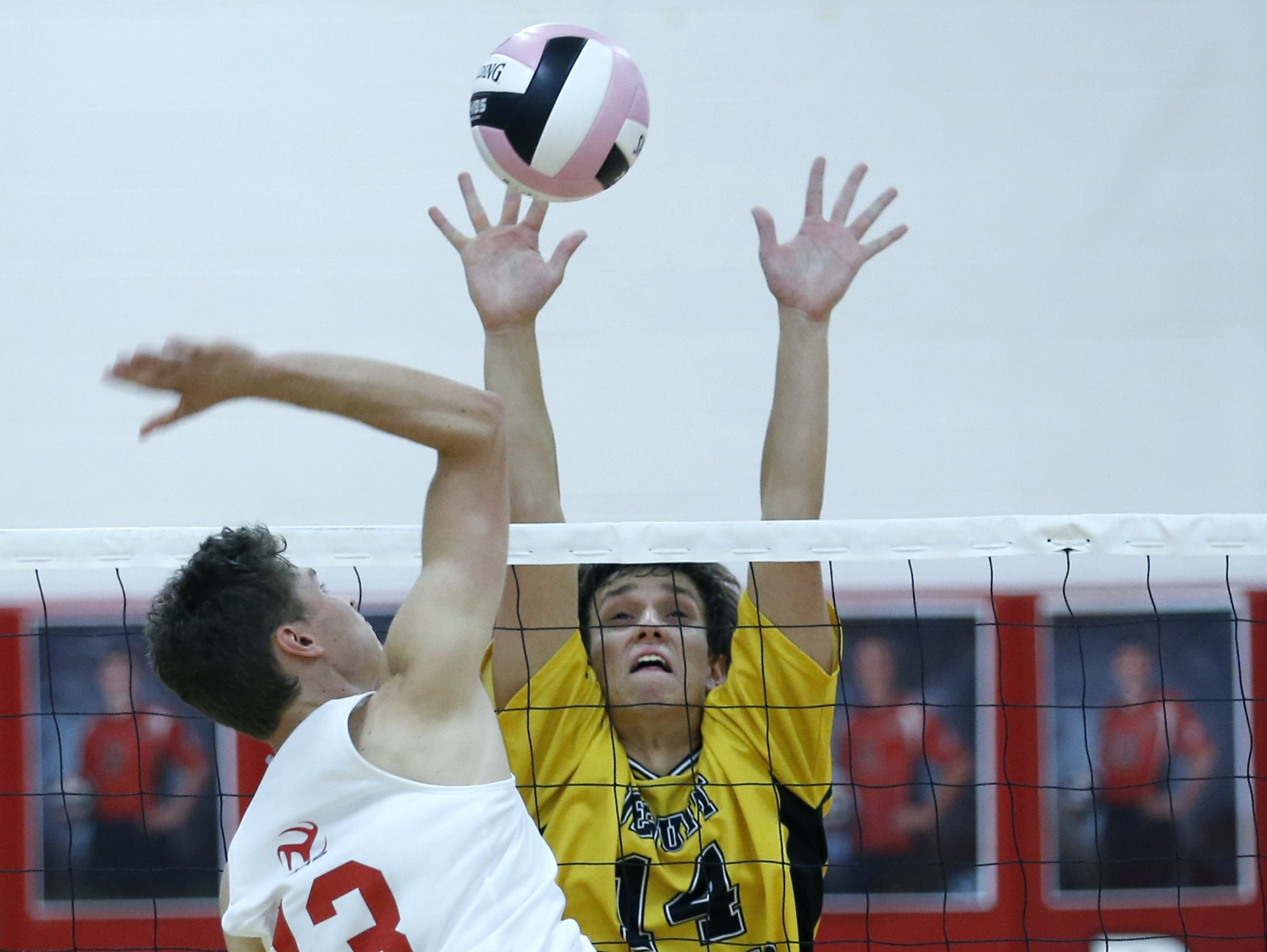Penfield's Andy Scott and McQuaid's Christian Pawelek battle in an early season match.
