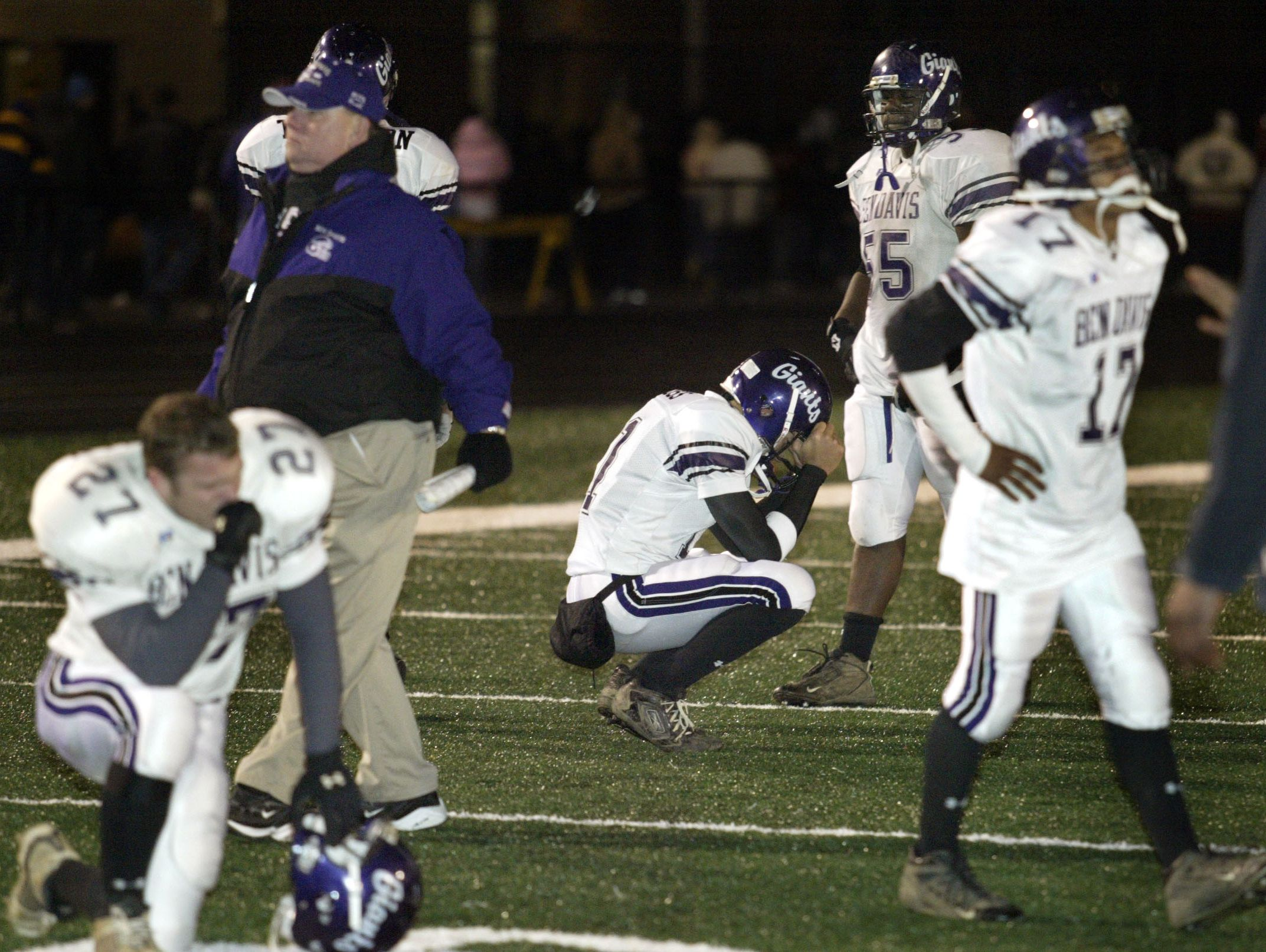 FILE – Ben Davis players react after losing to Warren Central in the playoffs in 2004.