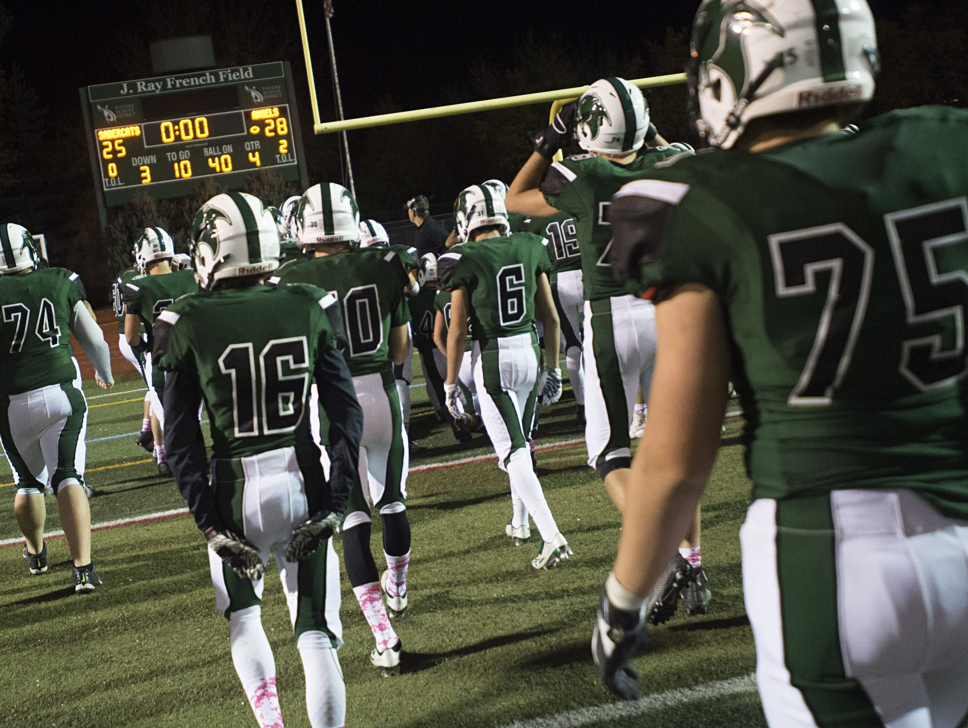 The Fossil Ridge High School football team leaves the field following a 28-25 loss to Denver East at French Field on October 21, 2016. Despite going 7-3 this season, the SaberCats missed the Class 5A playoffs.