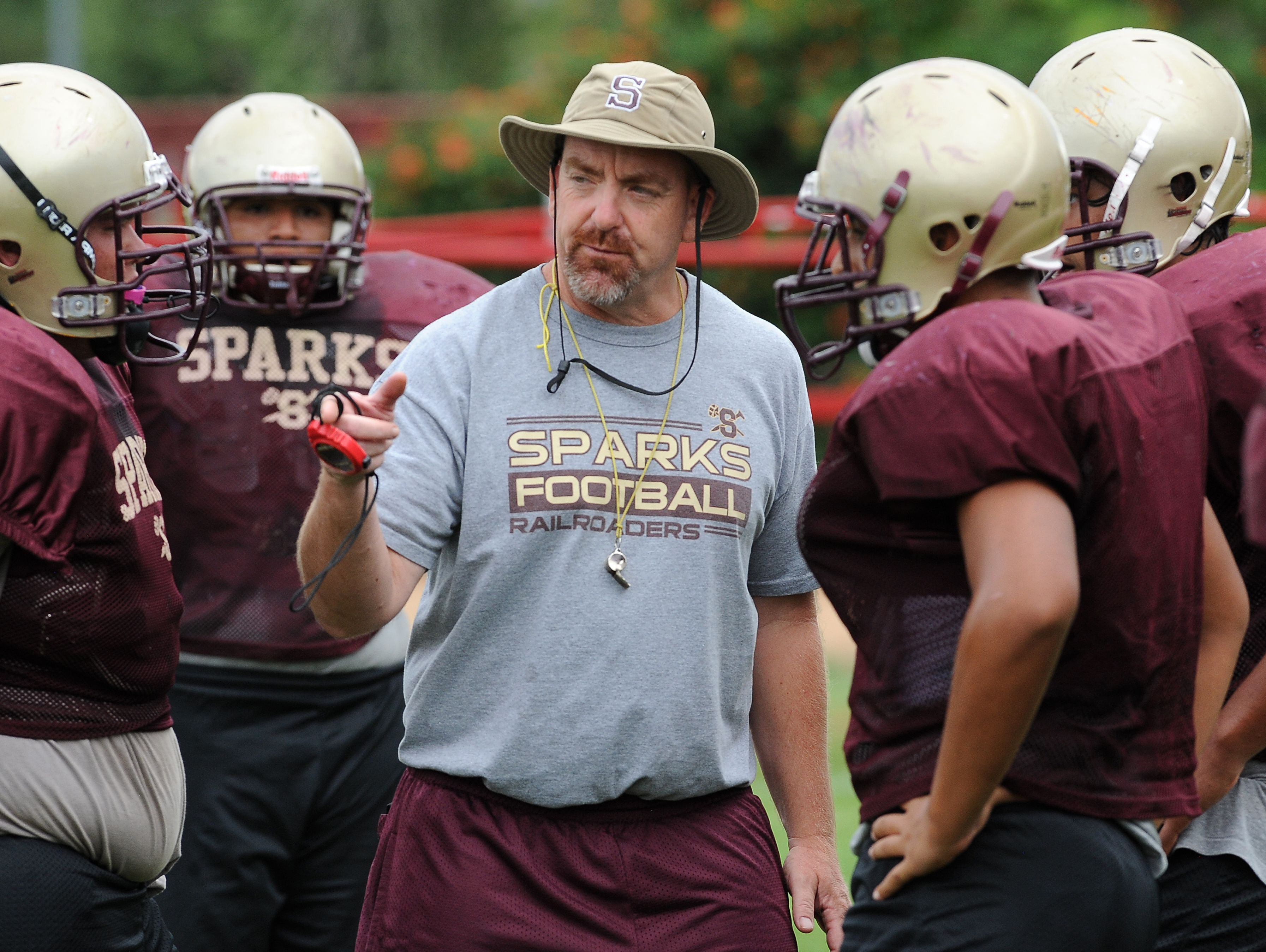 Sparks football coach Rob Kittrell gives instructions during practice at Sparks High School on Aug. 21, 2013.