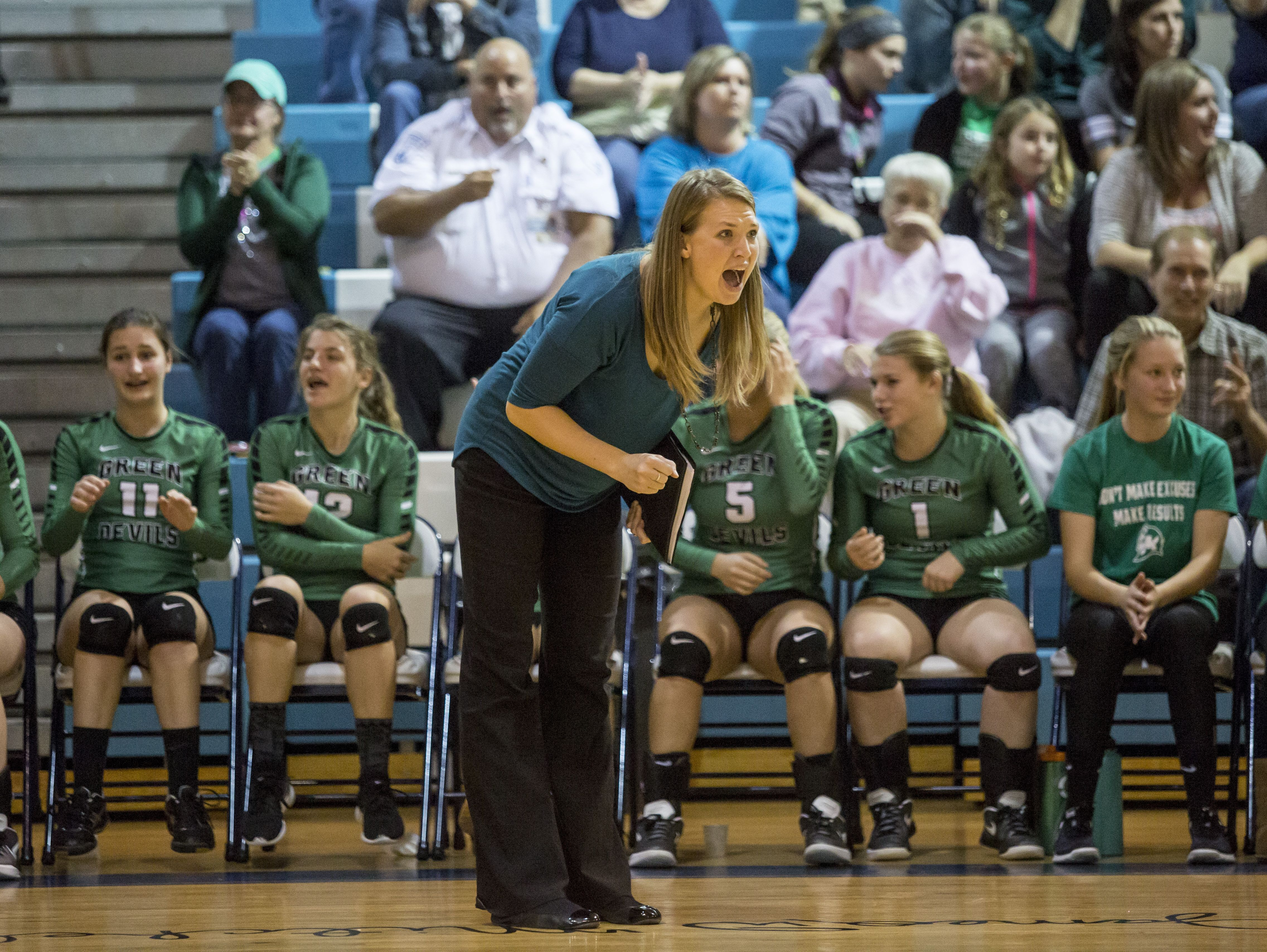 Brown City coach Jenna Welke yells from the sideline during a Class C regional volleyball game Thursday, Nov. 10, 2016 at Flint Hamady High School.