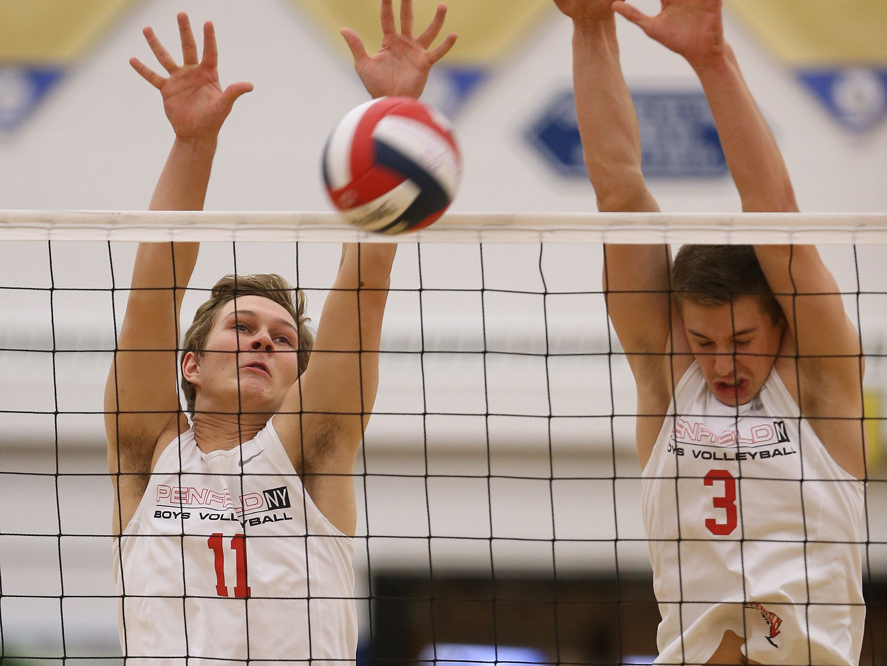 Penfield's Jack Burke (11) and Danny Marcy (3) go up for the block against McQuaid in the Class A final.