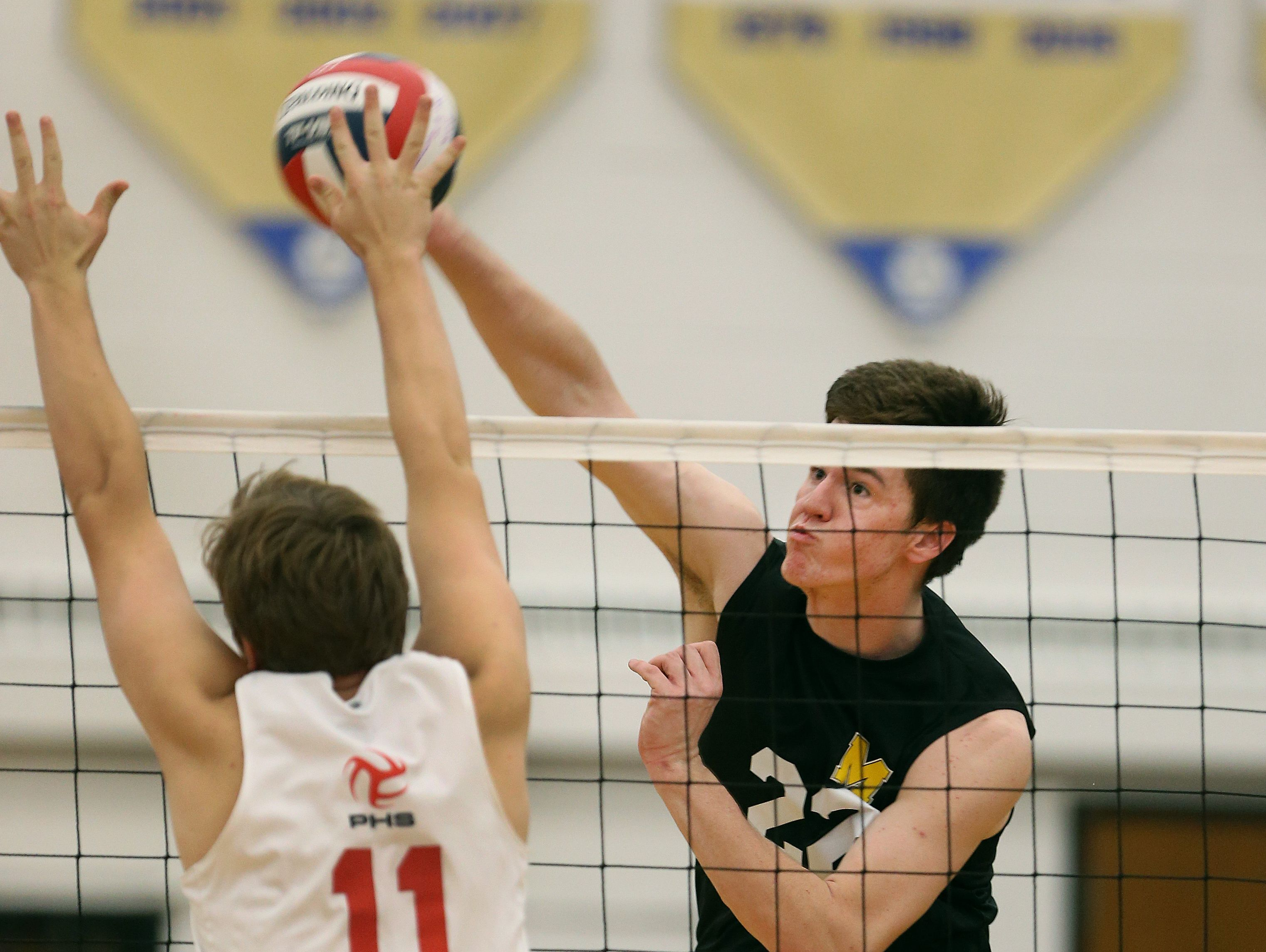 McQuaid's Ryan Dorgan goes up against Penfield's Jack Burke in Class A final.